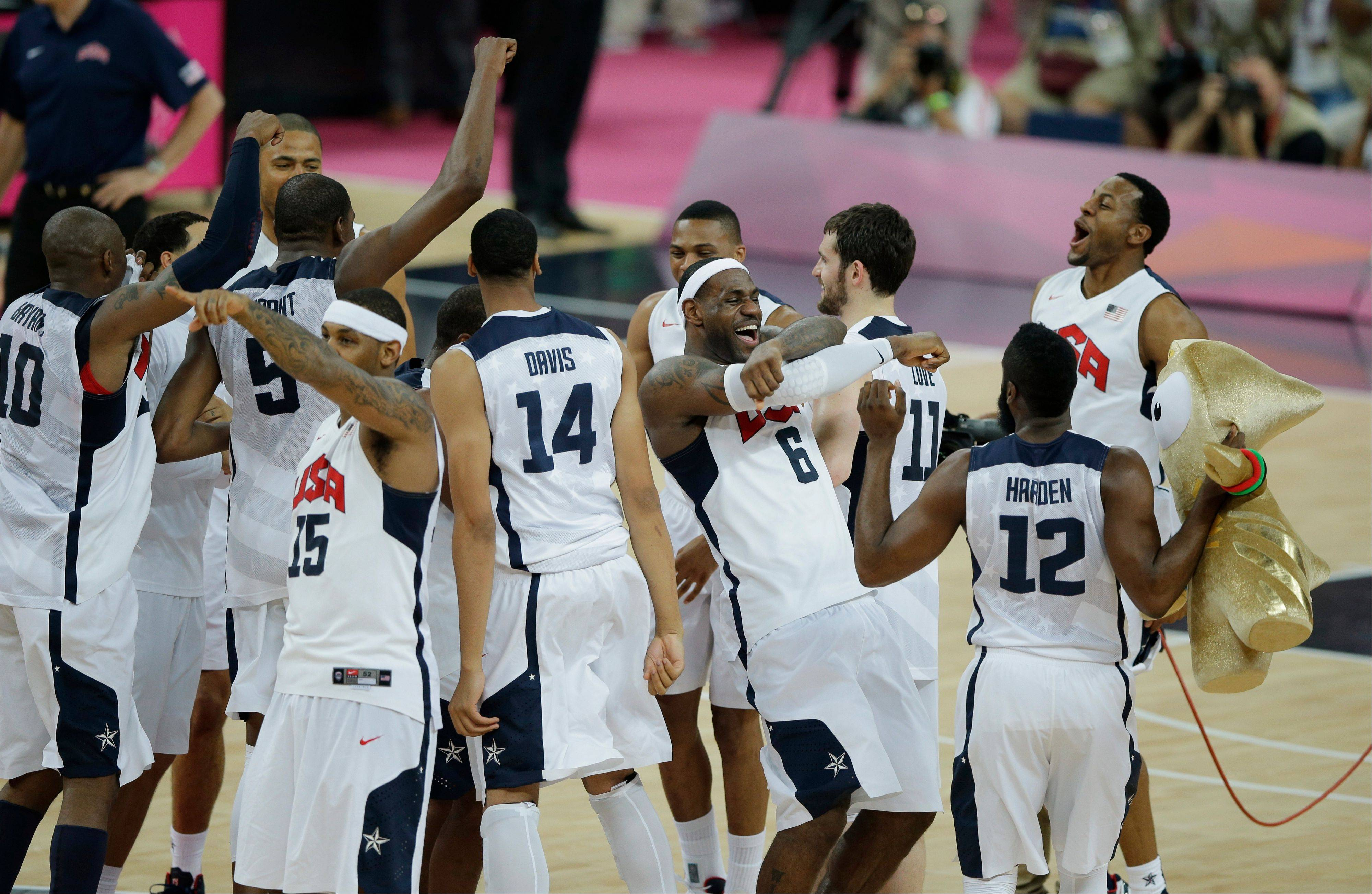 Members of the United States basketball team celebrate after defeating Spain in the men's gold medal basketball game at the 2012 Summer Olympics Sunday.