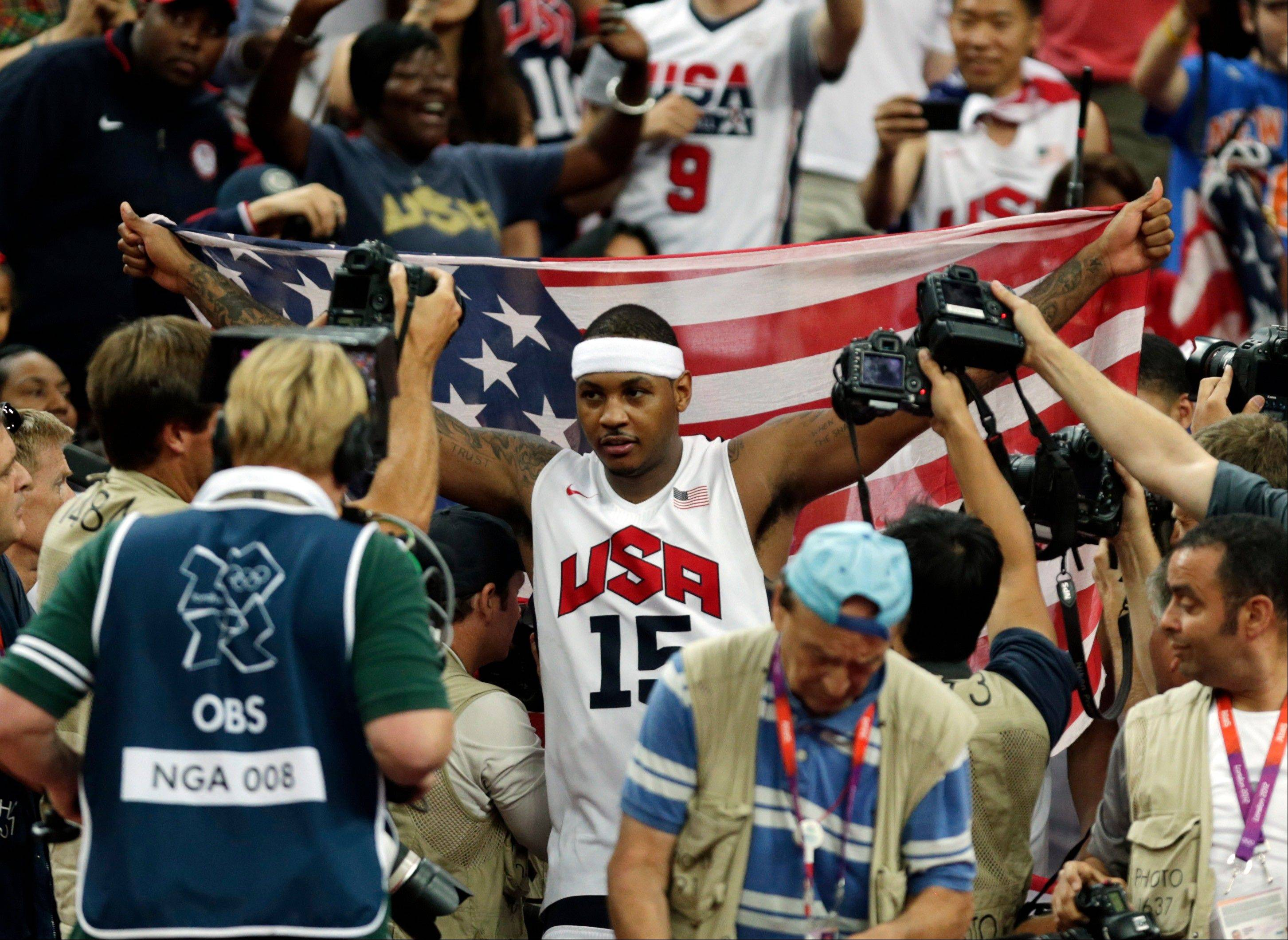 United States' Carmelo Anthony celebrates after the men's gold medal basketball game at the 2012 Summer Olympics Sunday.