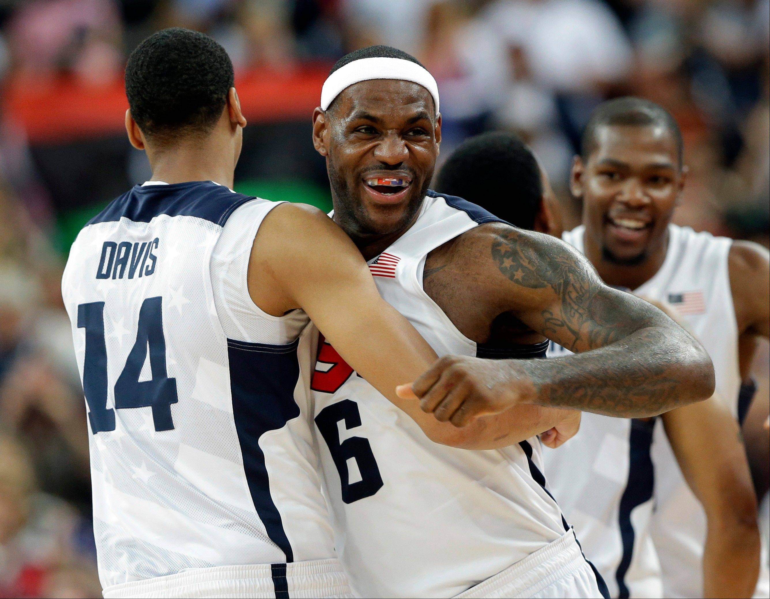 United States' LeBron James and Anthony Davis celebrate after the men's gold medal basketball game at the 2012 Summer Olympics Sunday in London. USA won 107-100.