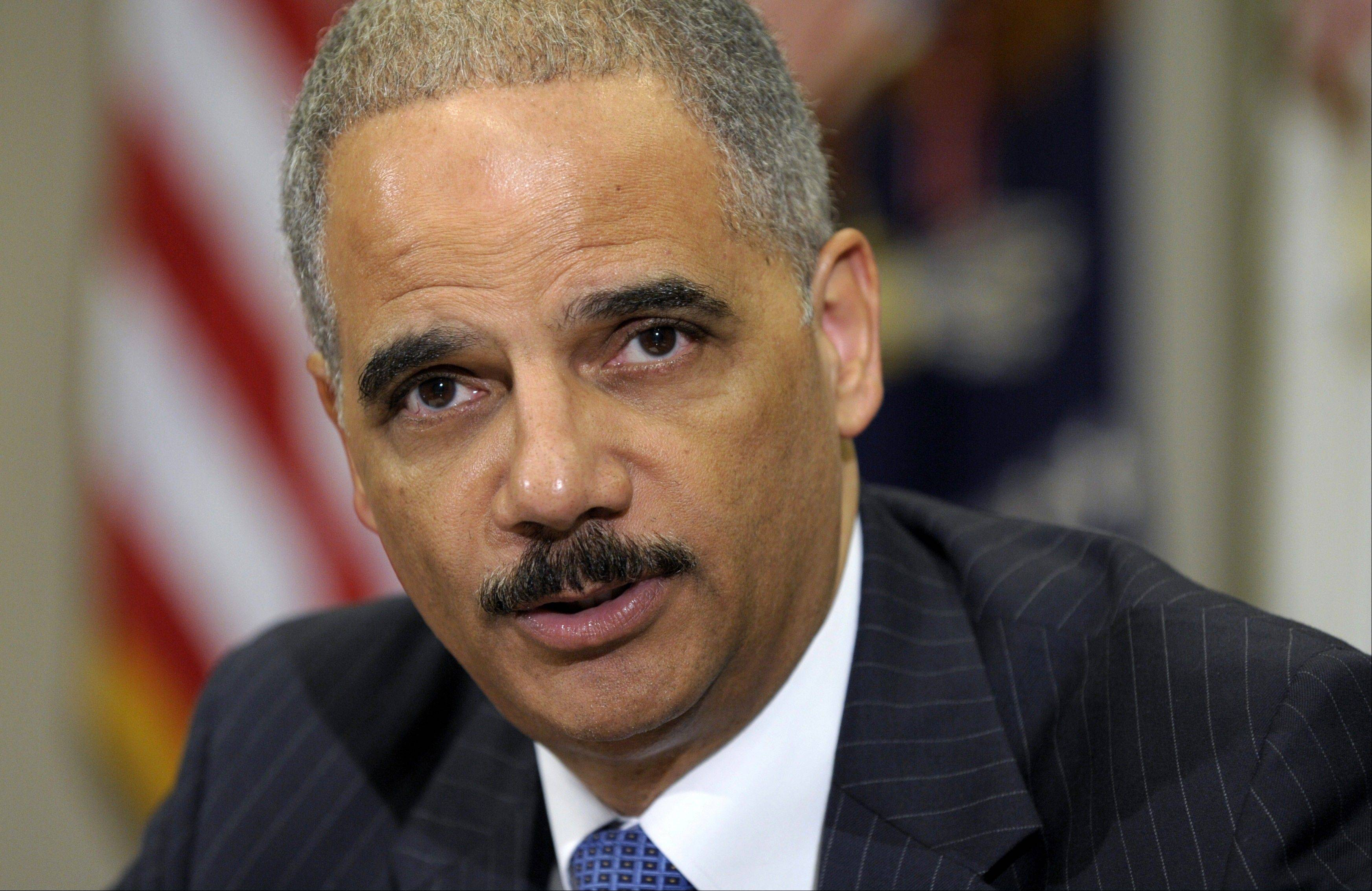 In this July 26, 2012 file photo, Attorney General Eric Holder speaks in the Cabinet Room of the White House in Washington. The Republican-run House has asked a federal court to enforce a subpoena against Attorney General Eric Holder. The subpoena demands that Holder produce records related to a bungled gun-tracking operation known as Operation Fast and Furious. The failure of Holder and House Republicans to work out a deal on the documents led to a vote in June that held the attorney general in contempt of Congress.