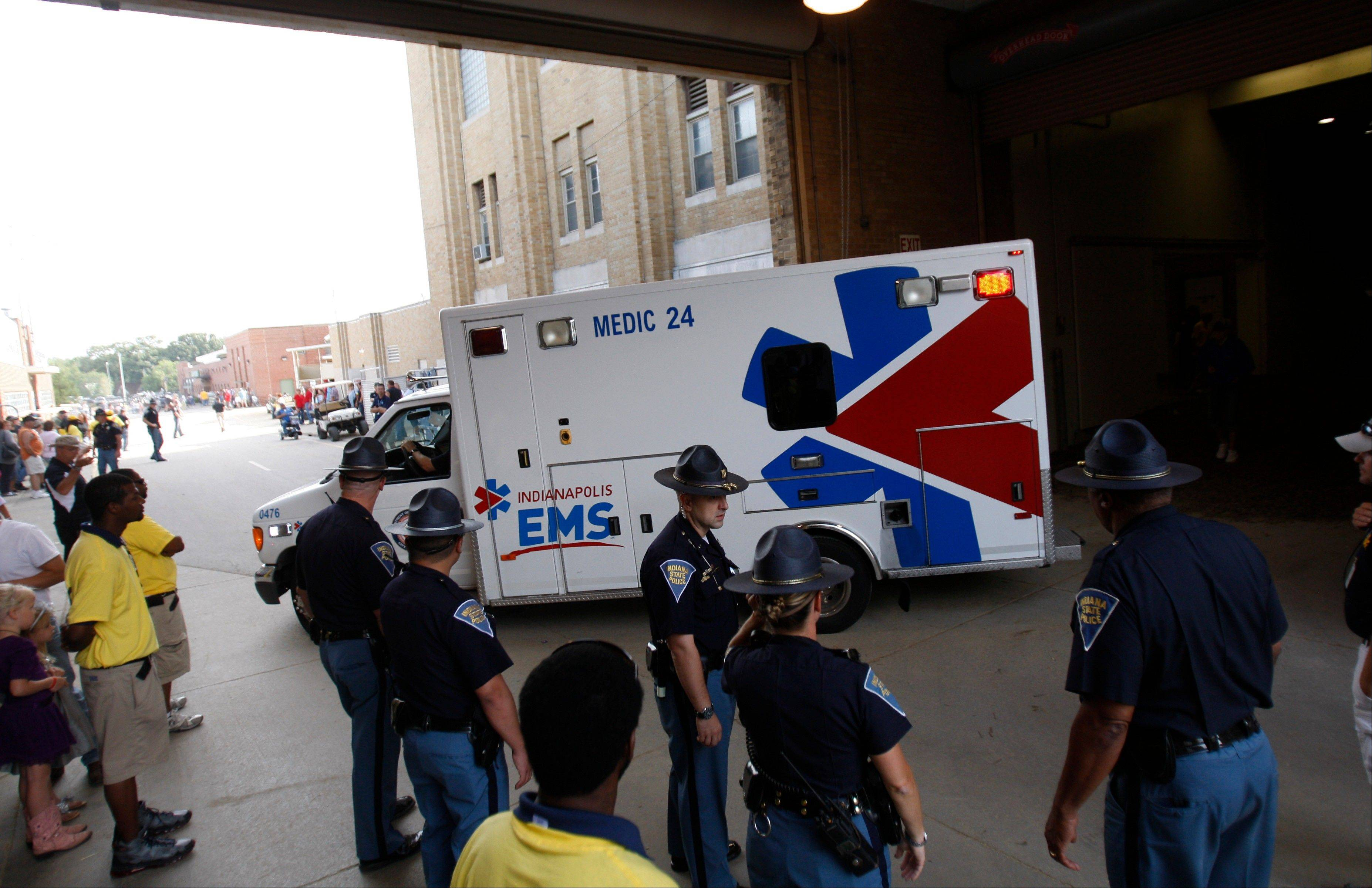 An ambulance leaves the Indiana State Fair Coliseum after a stage coach overturned at the Indiana State Fair Sunday.