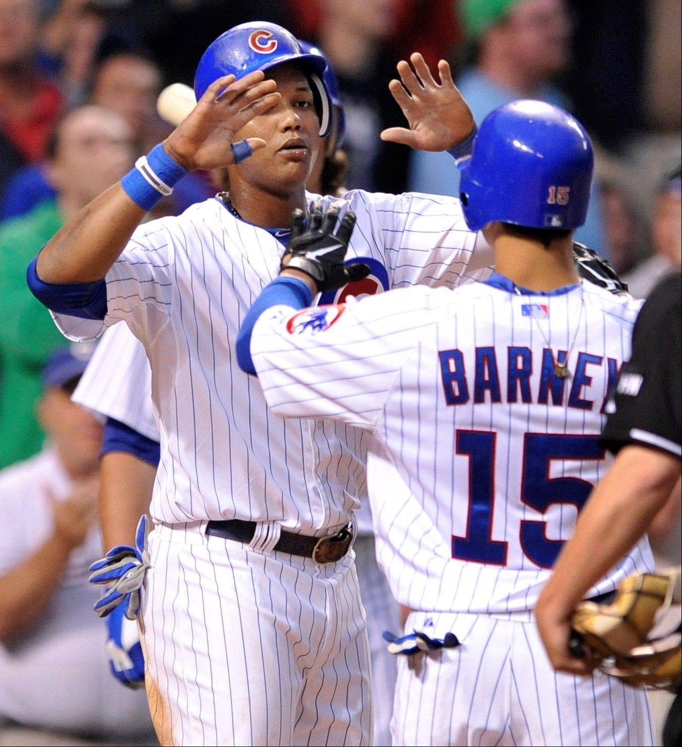 The Cubs� Darwin Barney celebrates with teammate Starlin Castro after hitting a 2-run home run against the Houston Astros in the second inning Monday night. The Cubs won 7-1.
