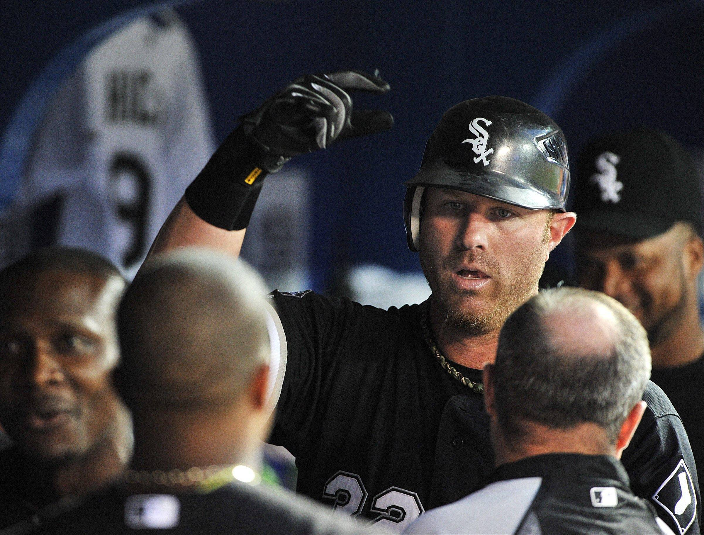 White Sox's Adam Dunn celebrates a home run against the Toronto Blue Jays during the fourth inning of a baseball game Monday in Toronto.