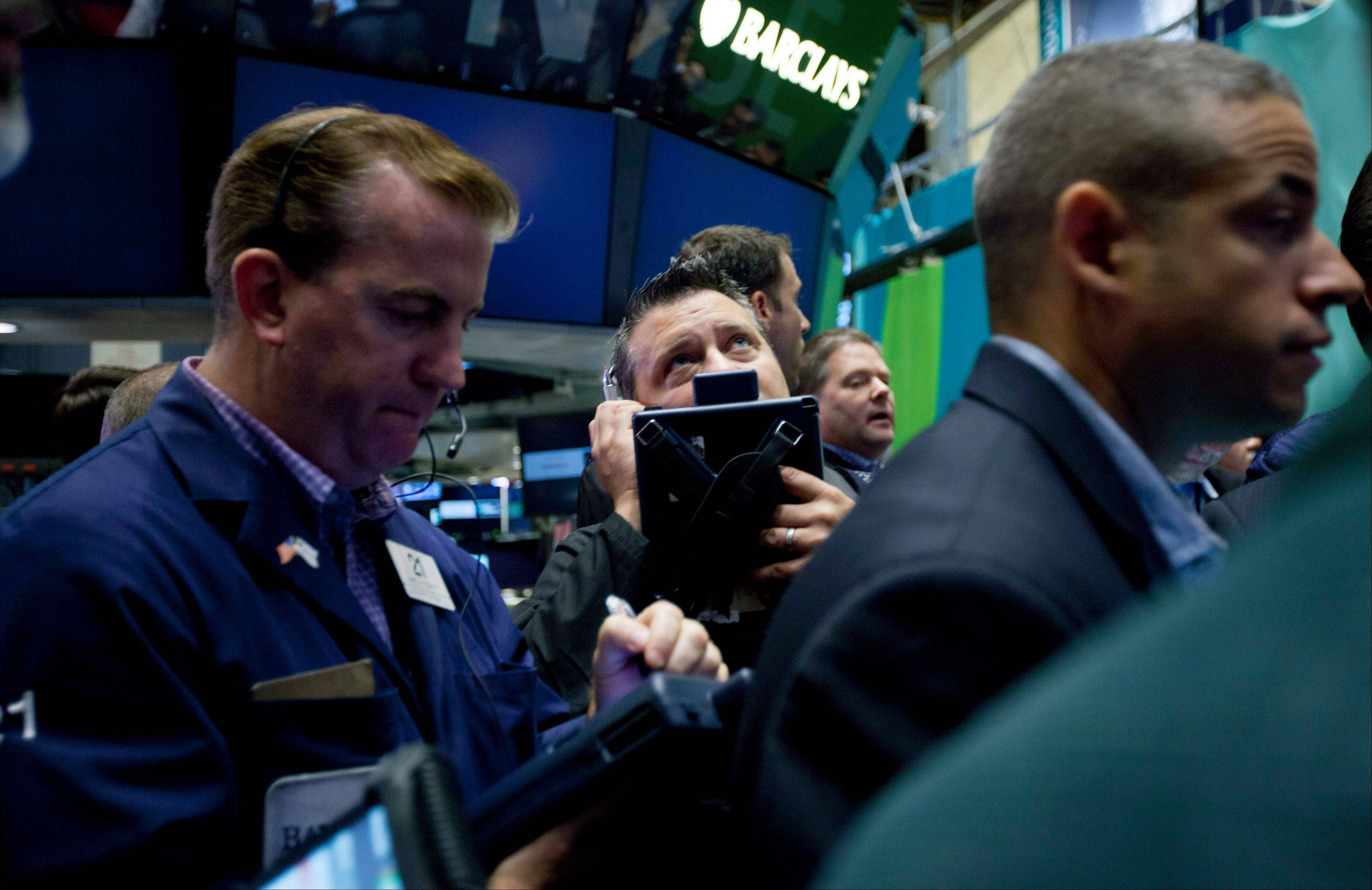 Traders work on the floor of the New York Stock Exchange, Friday, Aug. 10, 2012, in New York.