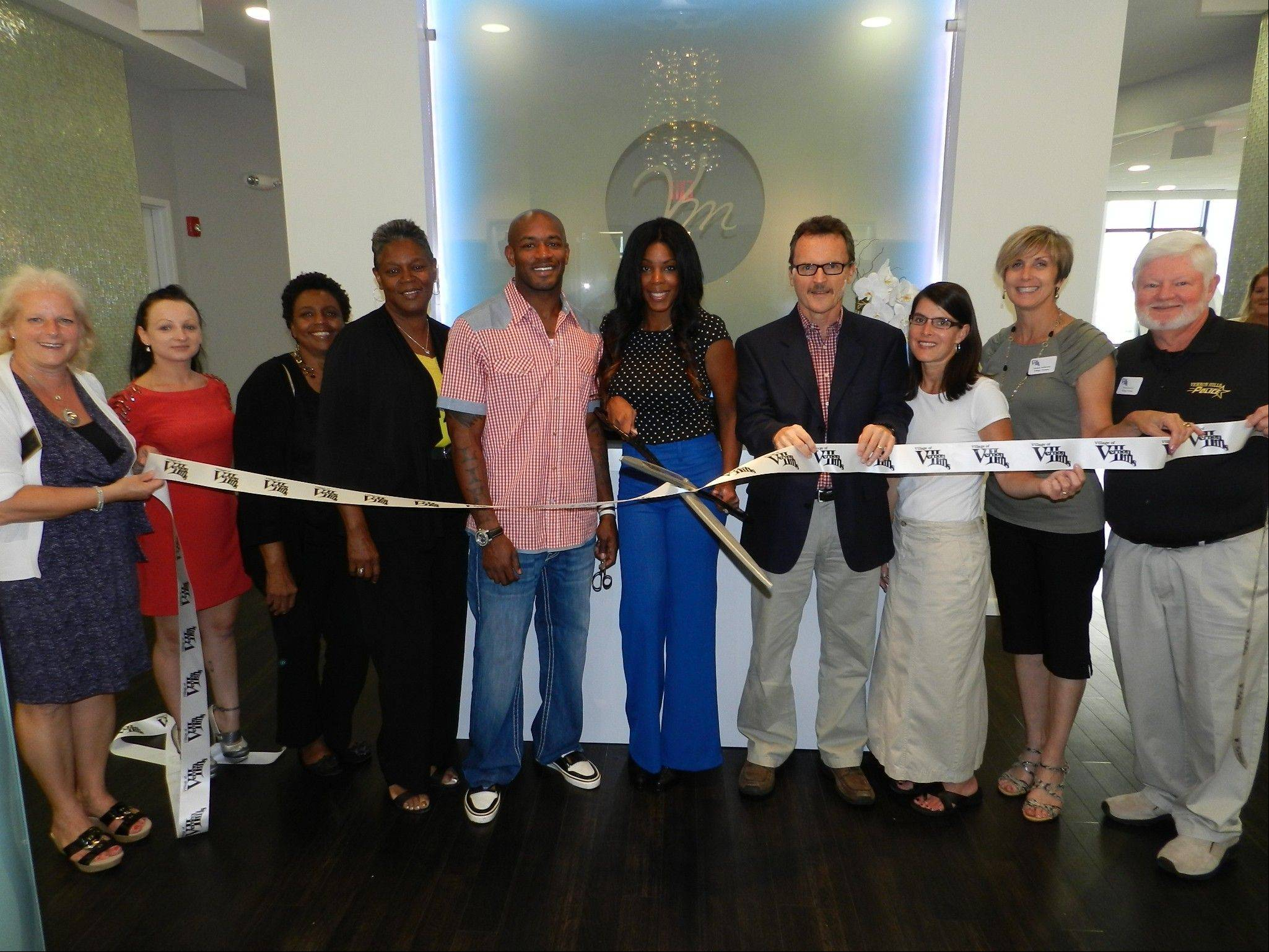 Venus vs. Marz Spa owners Brandon and Ranee McGowan, at center, cut the ribbon celebrating the recent grand opening of the luxury spa lounge in Vernon Hills, along with, from left, GLMV Chamber Executive Director Alese Campbell, Mike Allison, village of Vernon Hills, and other business leaders and community officials.