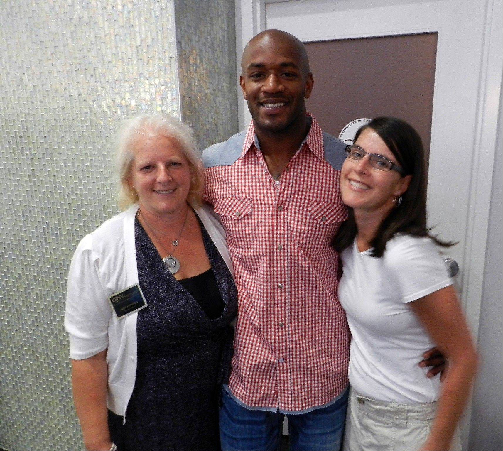 GLMV Chamber of Commerce Executive Director Alese Campbell, from left, spa co-owner and former Chicago Bear Brandon McGowan, and Amy Glover enjoy the festivities at the recent Venus vs. Marz grand opening celebration.