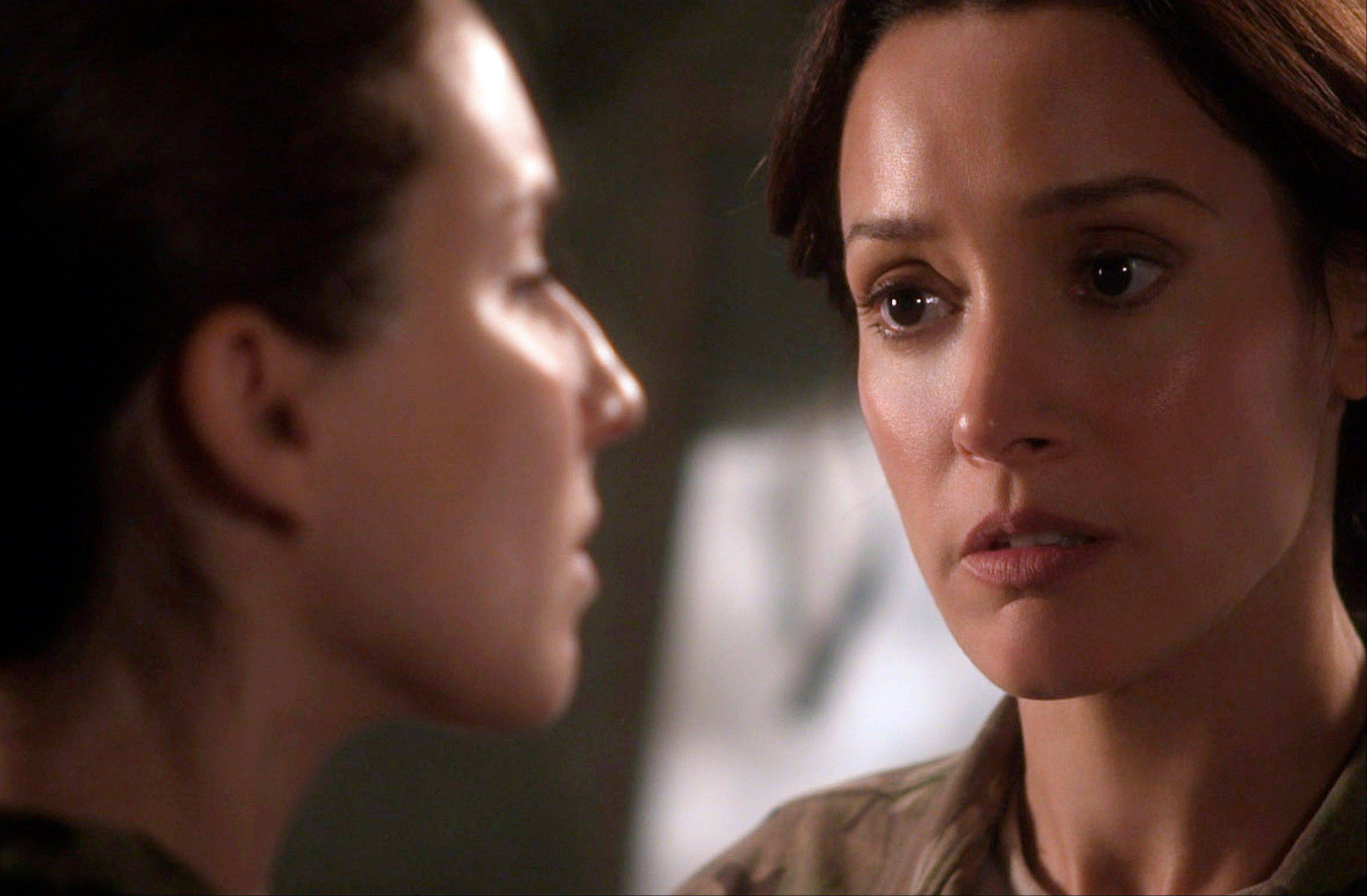 "Jennifer Beals, right, as Maj. Jo Stone in ""Lauren,"" confronts co-star Troian Bellisario who plays a female soldier who reports being raped. The three-part Web series gives a close-up look at the challenges and obstacles women service members face in trying to find justice after being raped."