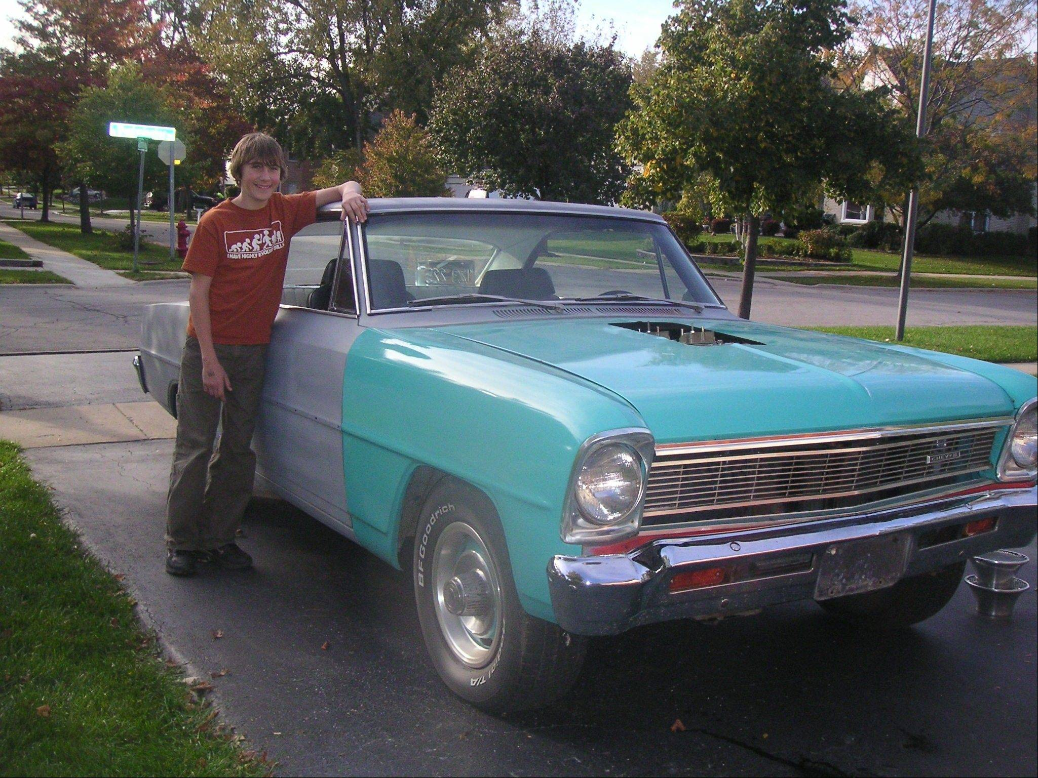 Tyler Dziedzina admires the Nova shortly after it was brought home in 2006.
