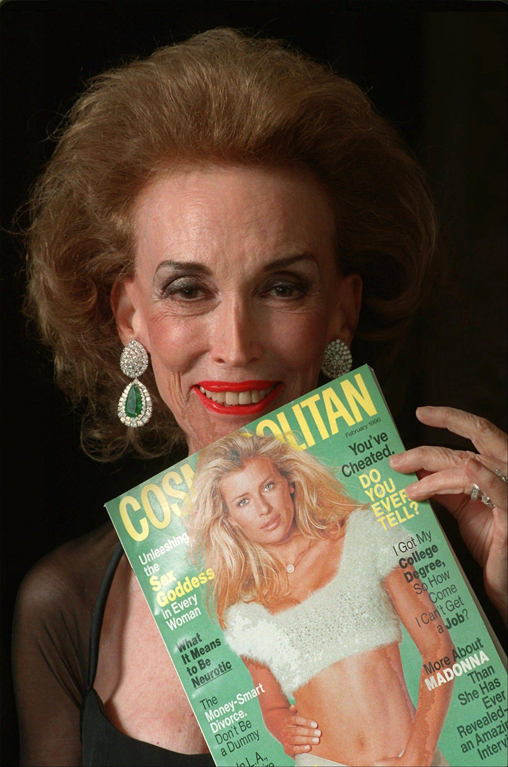 This Jan. 24, 1996 file photo shows Cosmopolitan Editor-in-Chief Helen Gurley Brown holding an issue of the magazine before a Waldorf-Astoria ceremony where she was honored with a Henry Johnson Fisher Award for lifetime achievement in the magazine industry in New York. Brown, longtime editor of Cosmopolitan magazine, died Monday, Aug. 13, 2012 at a hospital in New York after a brief hospitalization. She was 90.