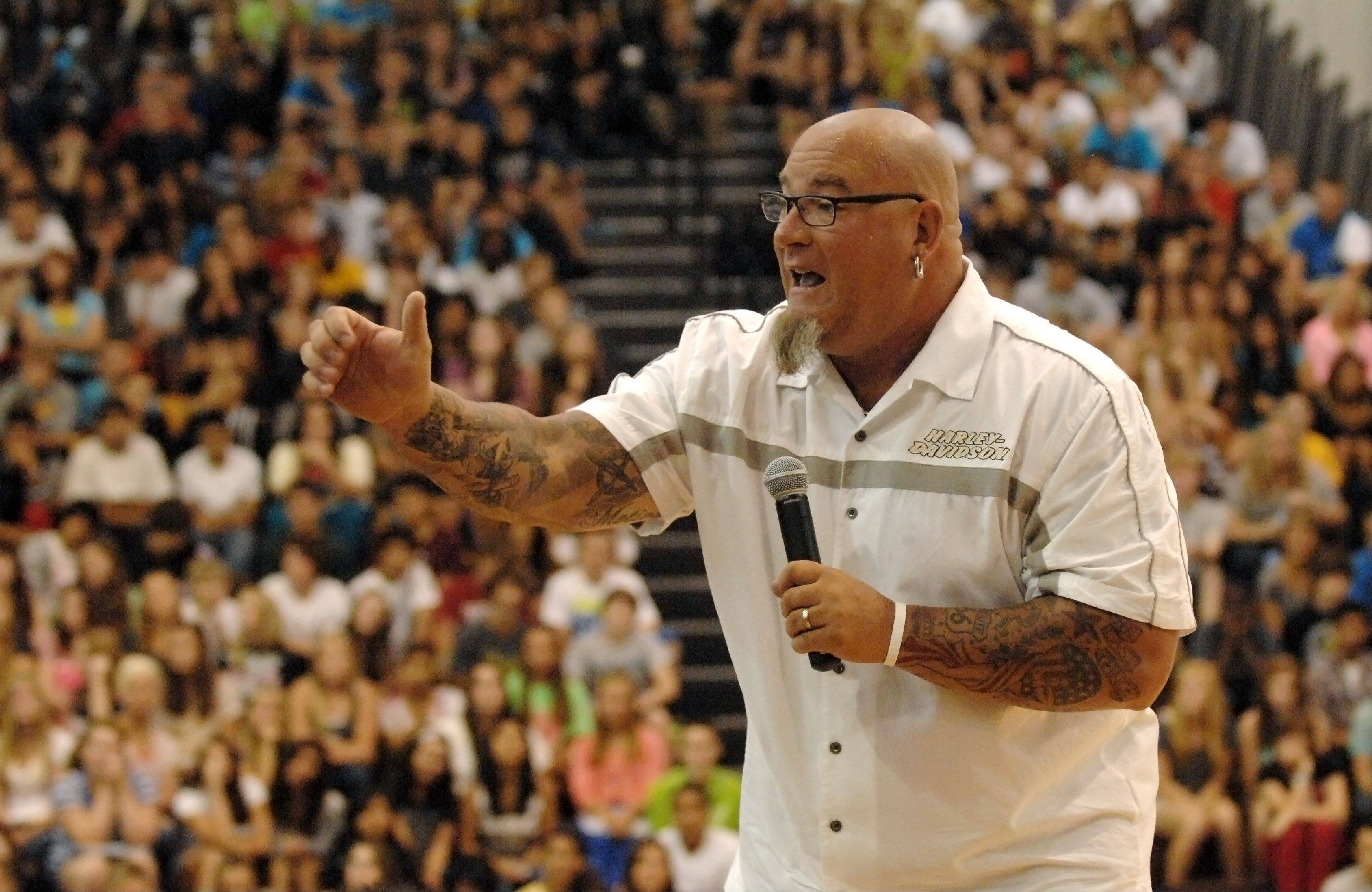 "MTV's ""MADE"" teen life coach Jeff Yalden speaks to students at Jacobs High School in Algonquin on the first day of school Monday."