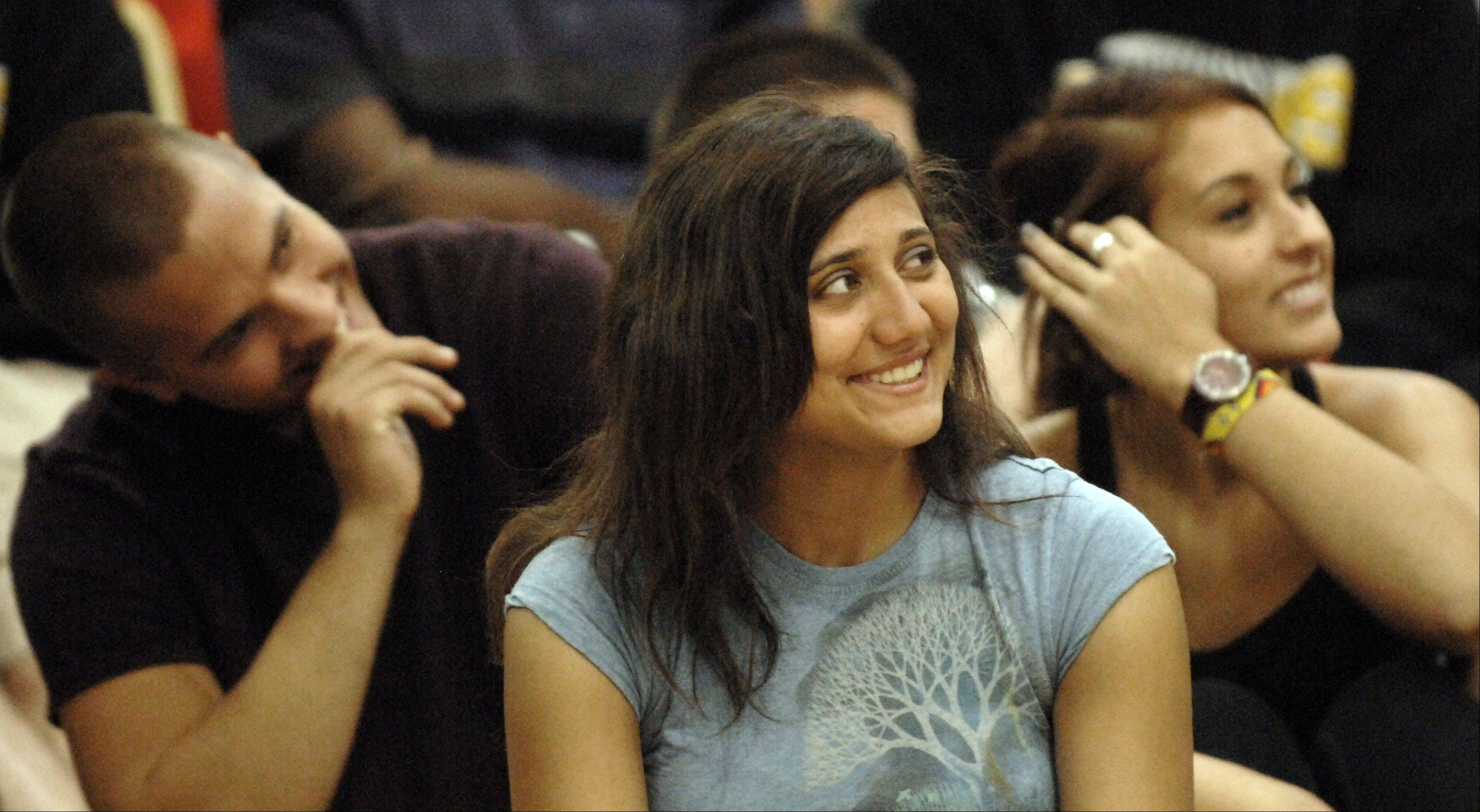 "Senior Nicole Vicicondi and her classmates laugh during a presentation by MTV ""MADE"" teen life coach Jeff Yalden at Jacobs High School in Algonquin on the first day of school Monday."