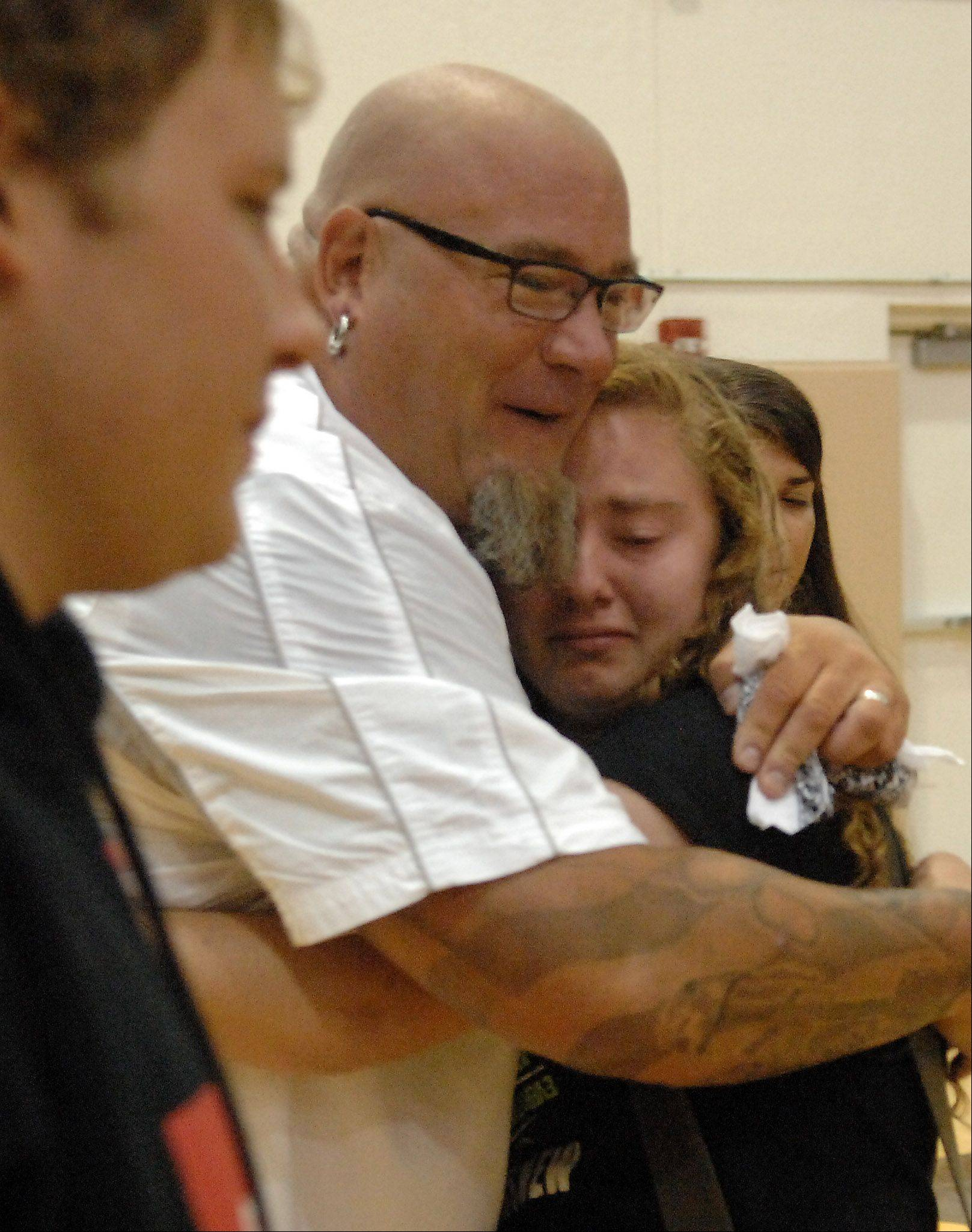 "MTV ""MADE"" teen life coach Jeff Yalden hugs junior Marissa Ahrens at Jacobs High School in Algonquin after his presentation on the first day of school Monday. His story about the death of his wife's grandfather reminded her of her grandfather's battle with Alzheimer's disease."