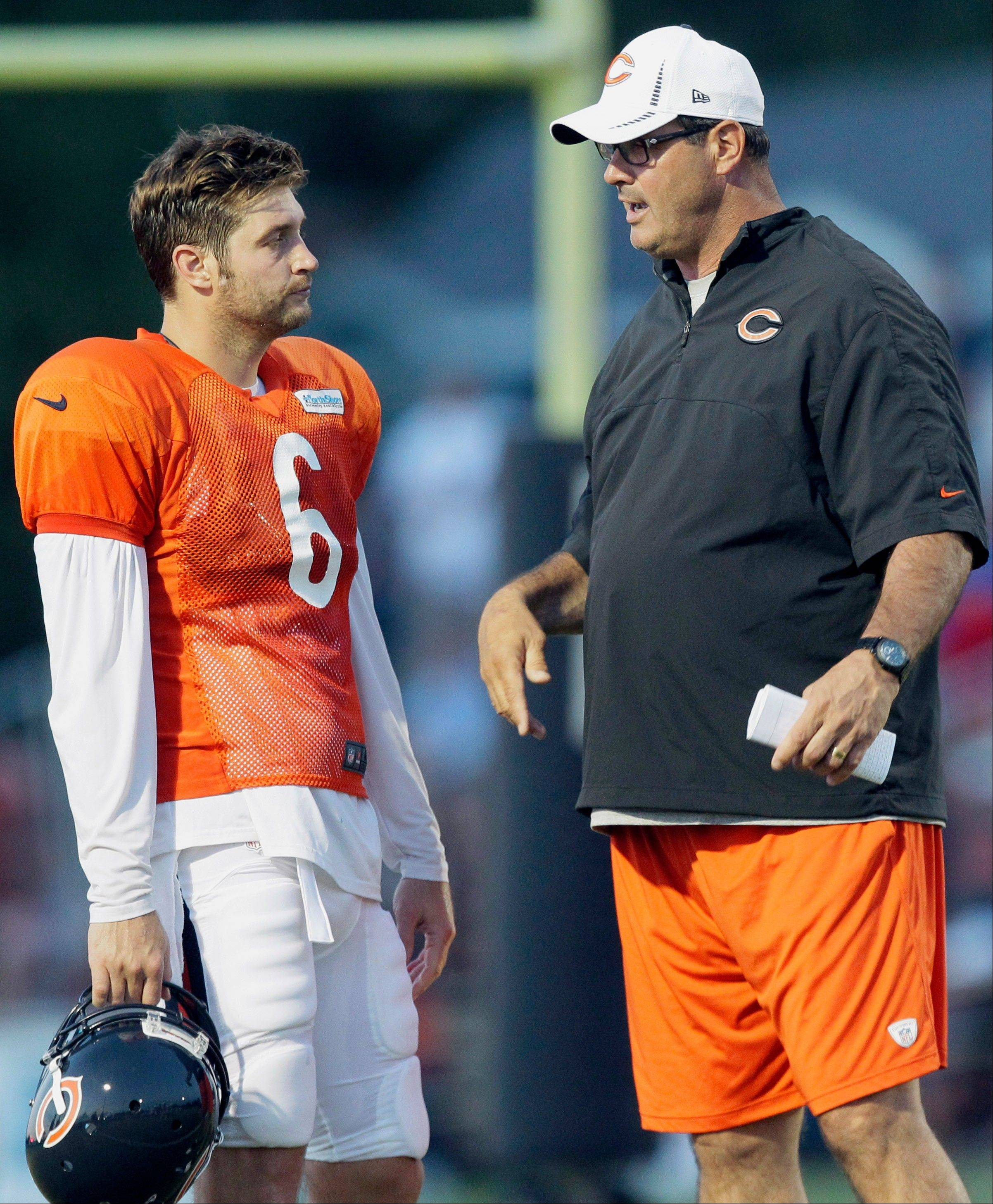 Bears offensive coordinator Mike Tice says he will have trouble sleeping at night until he knows that his line can protect quarterback Jay Cutler, right.