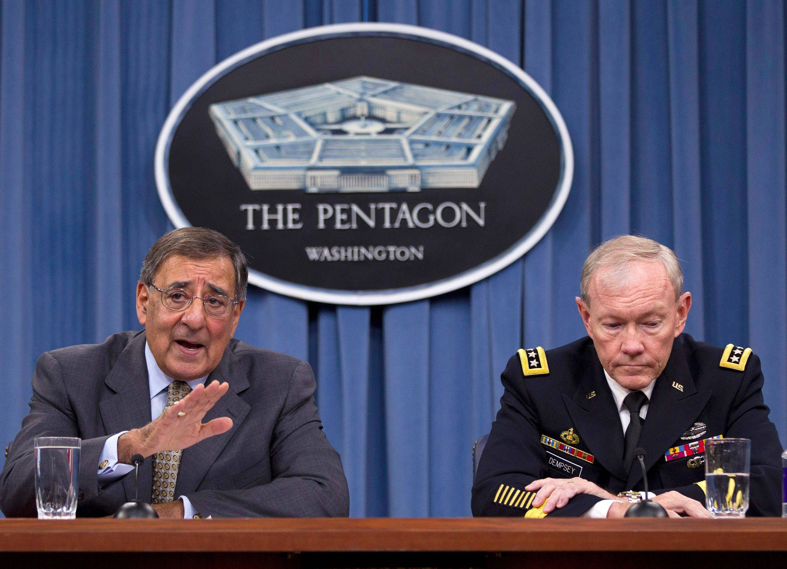 In this June 29, 2012 file photo, Defense Secretary Leon Panetta, left, accompanied by Joint Chiefs Chairman Gen. Martin Dempsey, gestures during a news conference at the Pentagon. Panetta and Dempsey say Iran has increased its presence in Syria, aiding the regime in fighting opposition looking to overthrow President Bashar Assad.