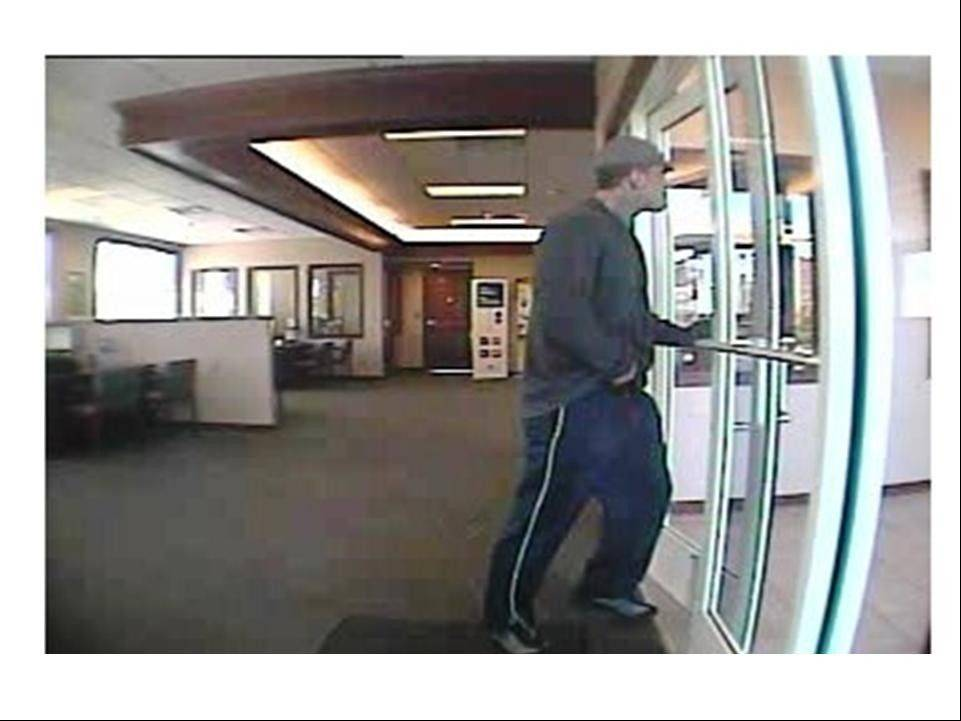 Authorities say this surveillance footage shows a man walking out of a West Chicago bank after robbing it Tuesday morning.