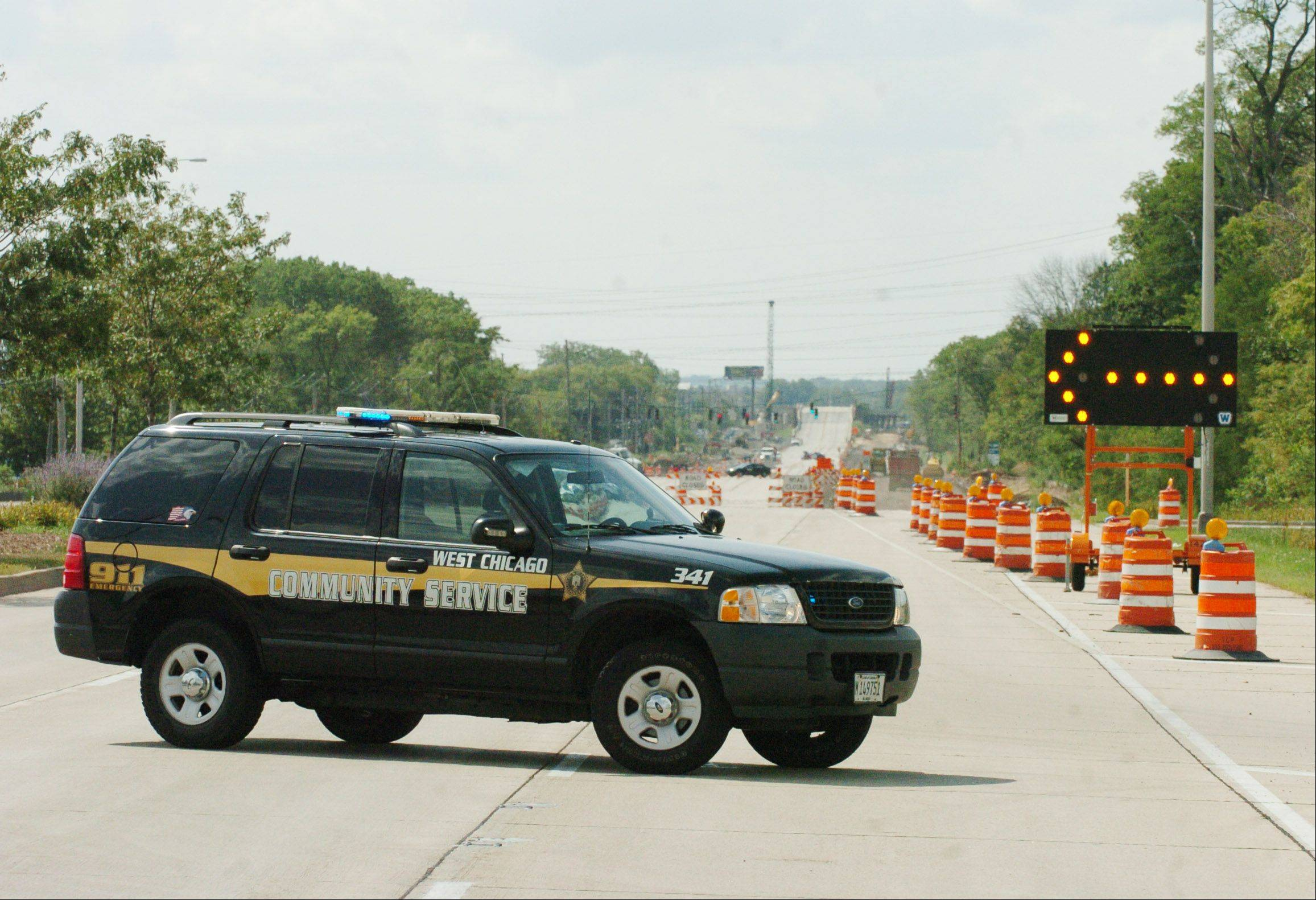 A West Chicago Community officer keeps guard over a gas leak along Route 64 in West Chicago Tuesday. The road was closed from Kautz to Powis. Motorists were encouraged to take alternate routes.
