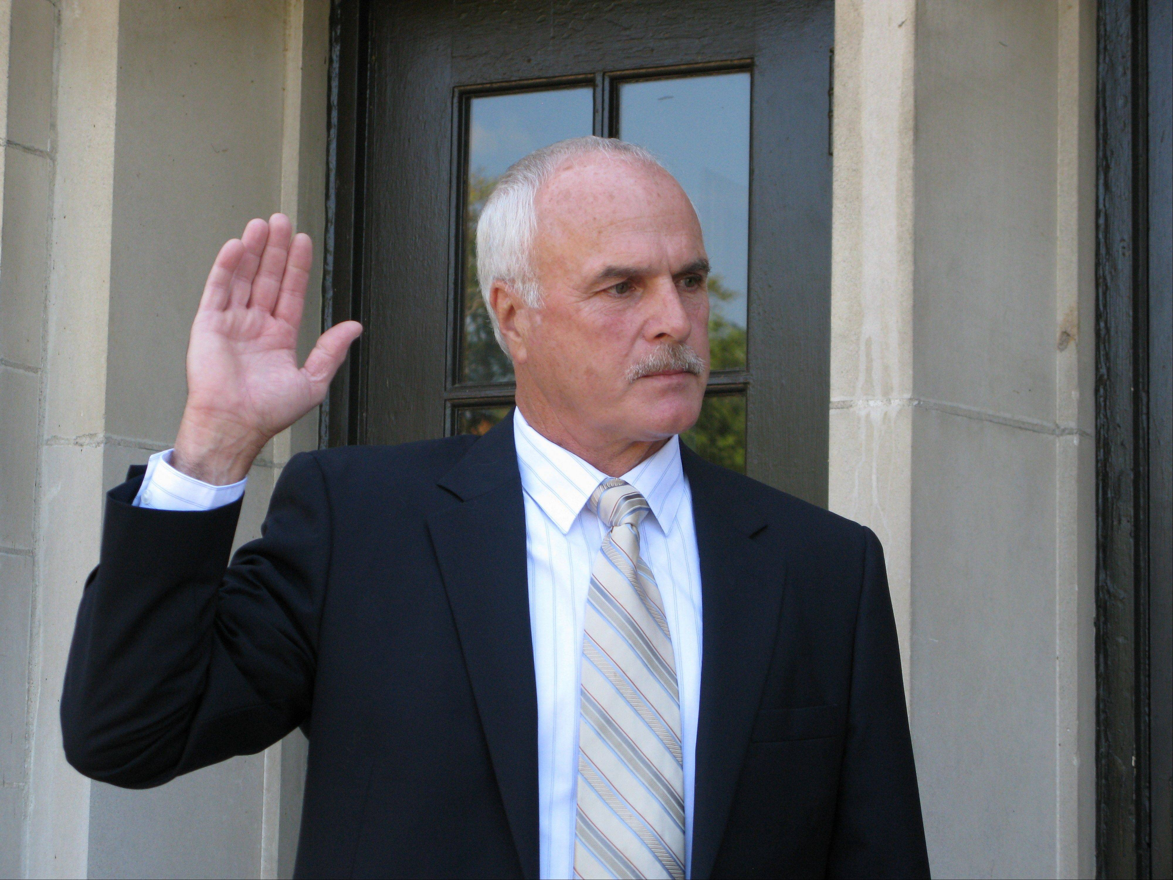 Former Sugar Grove Police Chief Brad Sauer was sworn in as temporary Kane County coroner Tuesday.