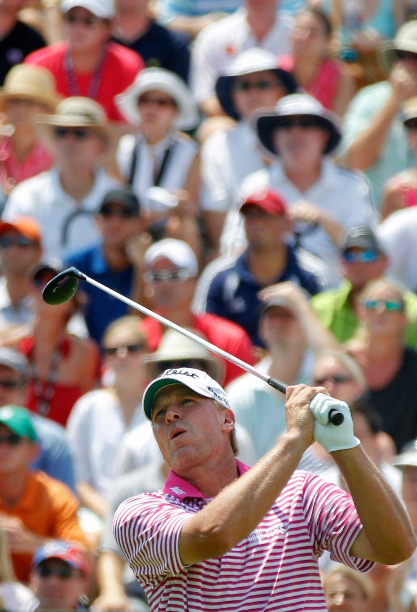 Steve Stricker watches his drive from the first tee during the final round of the PGA Championship golf tournament on the Ocean Course of the Kiawah Island Golf Resort in Kiawah Island, S.C., Sunday, Aug. 12, 2012. (AP Photo/Evan Vucci)