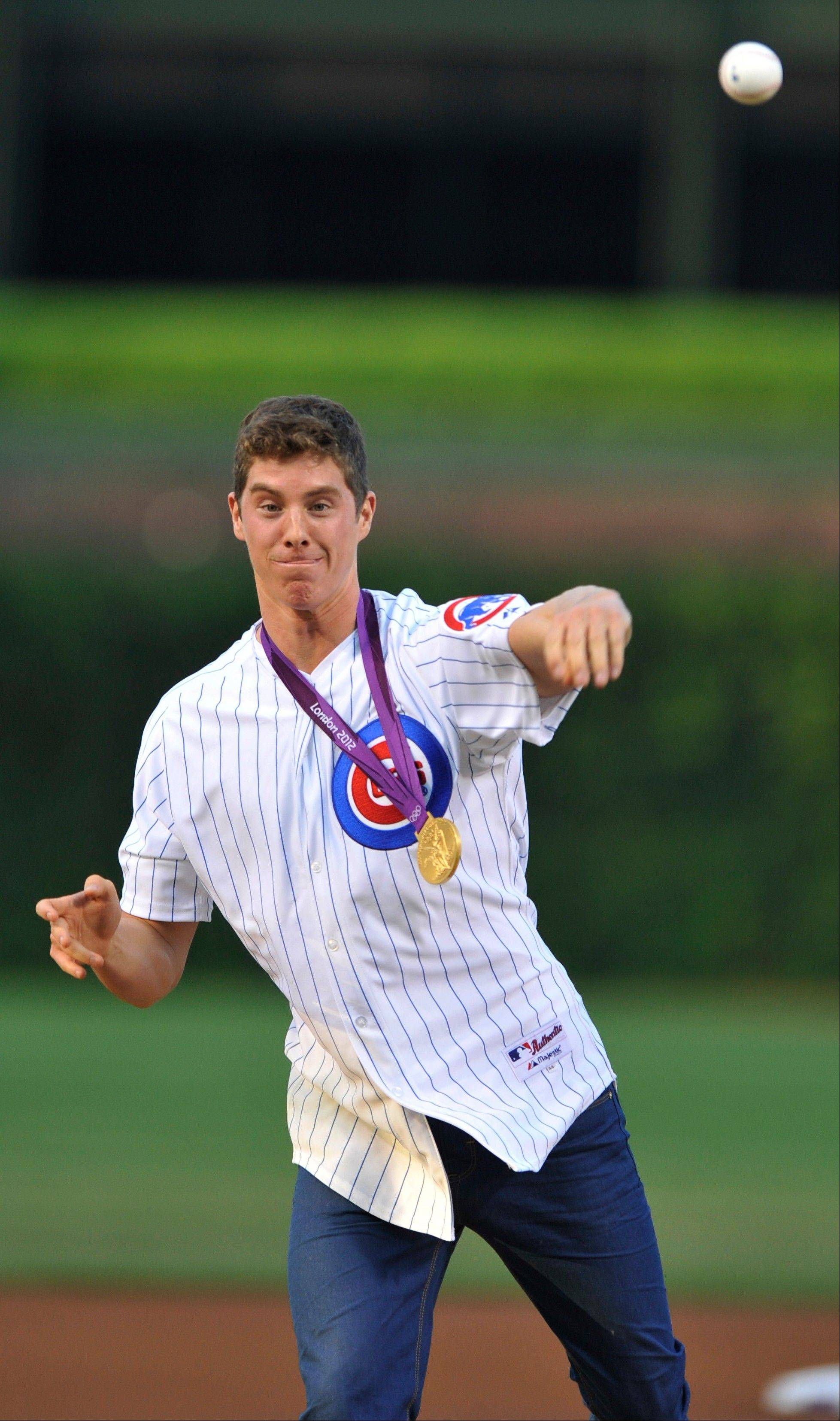 Olympic gold medalist Conor Dwyer throws out the ceremonial first pitch before the Cubs took on the Astros at Wrigley Field on Tuesday. Dwyer won a gold medal as a member of the U.S. 4x200-meter freestyle relay team.