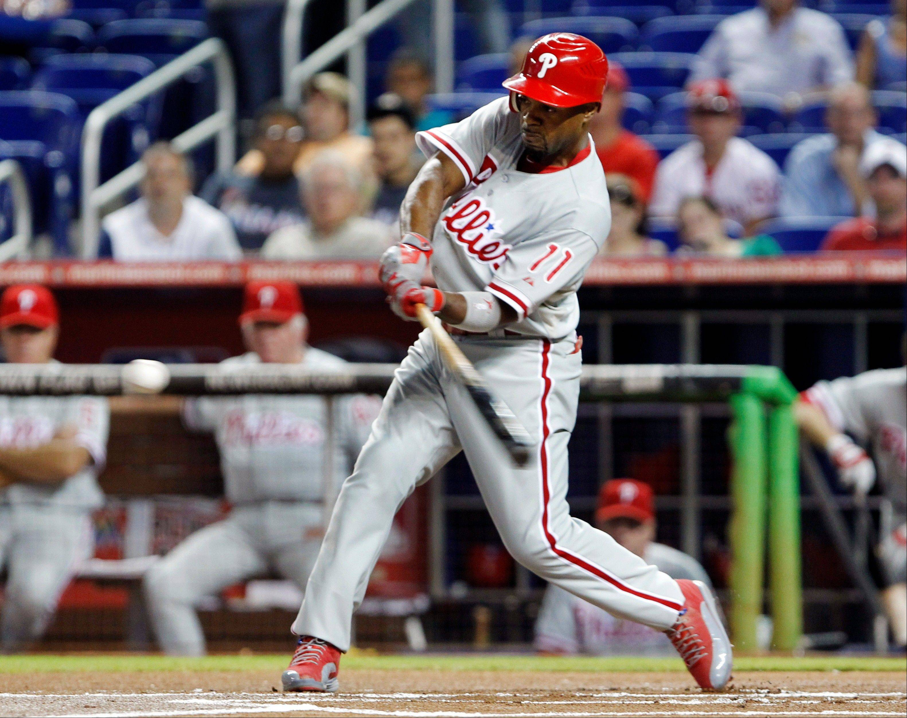 The Philadelphia Phillies� Jimmy Rollins hits a solo home run Tuesday during the first inning against the Miami Marlins.