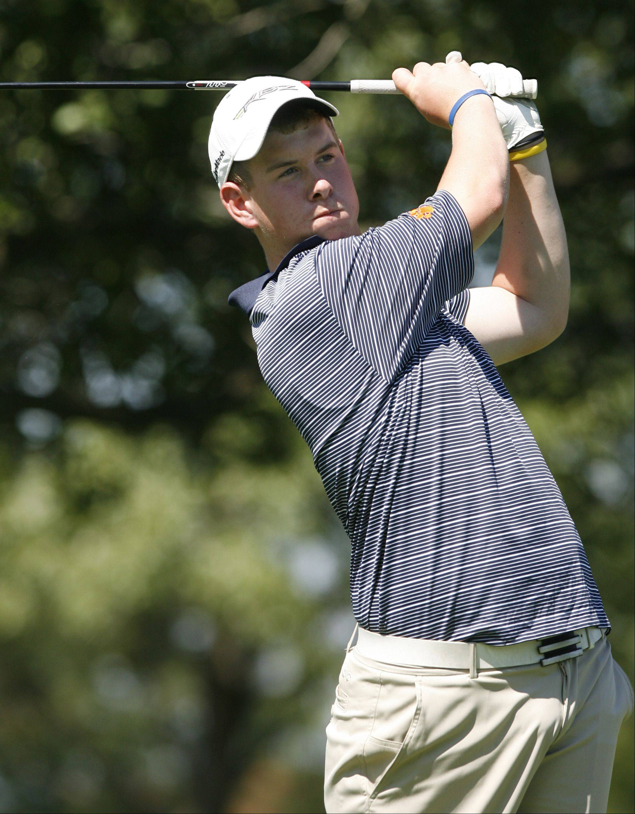 Naperville North�s Raymond Knoll tees off during the Vern McGonagle Memorial High School Golf Championship, held at the Naperville Country Club.