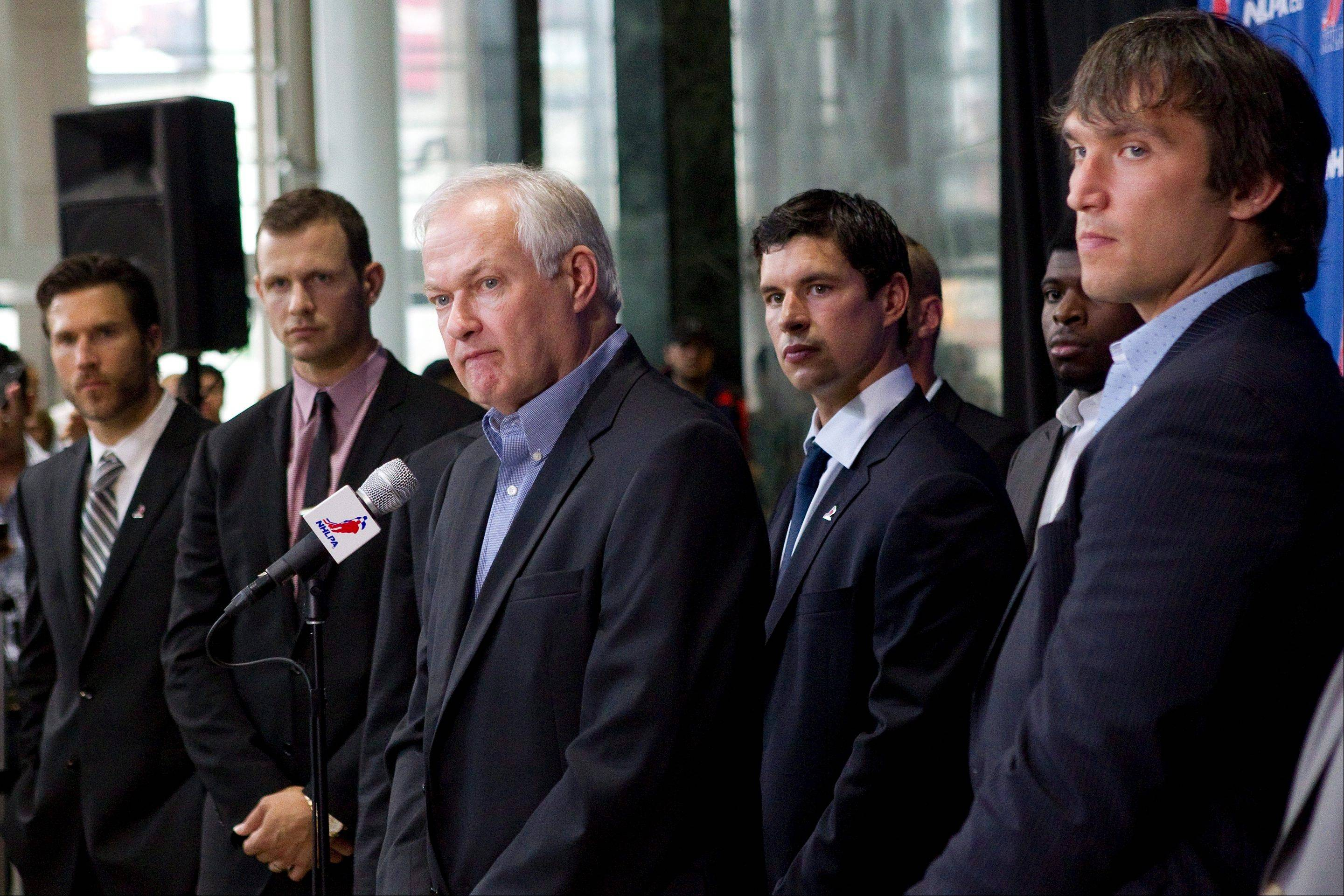 Donald Fehr, center, executive director of the NHL Players� Association, stands with players, from left, the Blackhawks� Steve Montador, the Ottawa Senators� Jason Spezza, the Pittsburgh Penguins� Sidney Crosby and the Washington Capitals� Alex Ovechkin as he speaks to reporters following collective bargaining talks in Toronto.