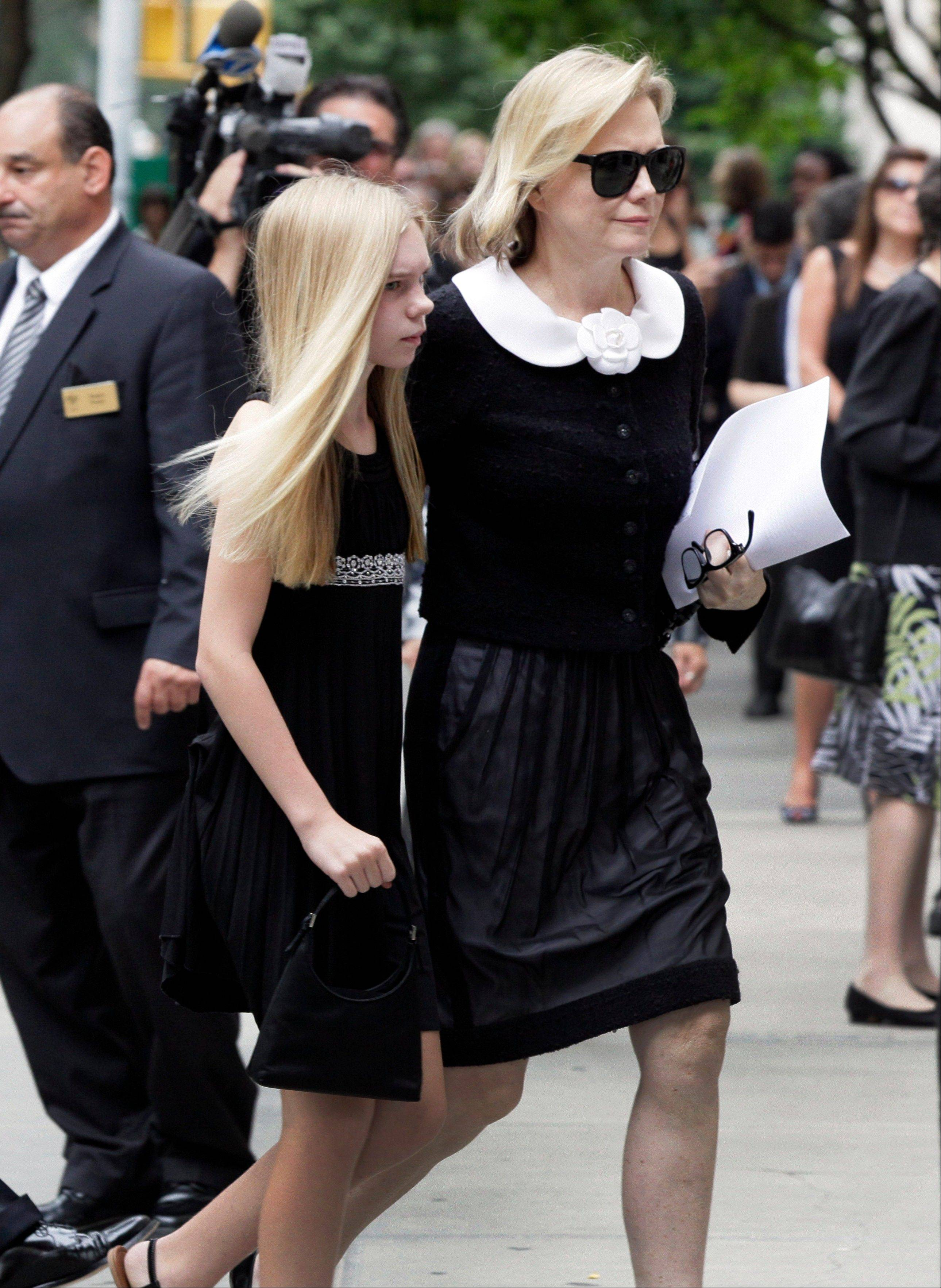 Terre Blair, wife of Marvin Hamlisch, arrives for his funeral service, in New York's Temple Emanu-El, Tuesday.