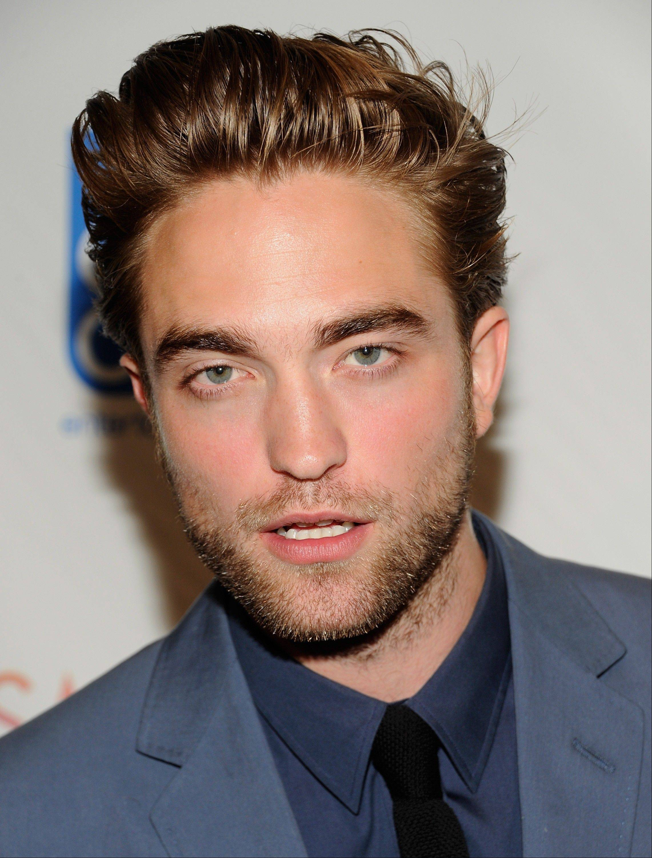 "Robert Pattinson attends the premiere of ""Cosmopolis"" at the Museum of Modern Art in New York on Monday."