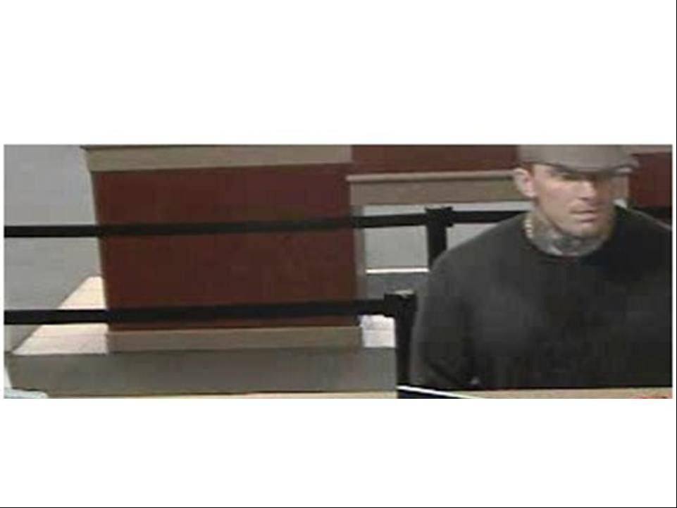 Police say this surveillance image shows a man robbing a West Chicago bank Tuesday morning.