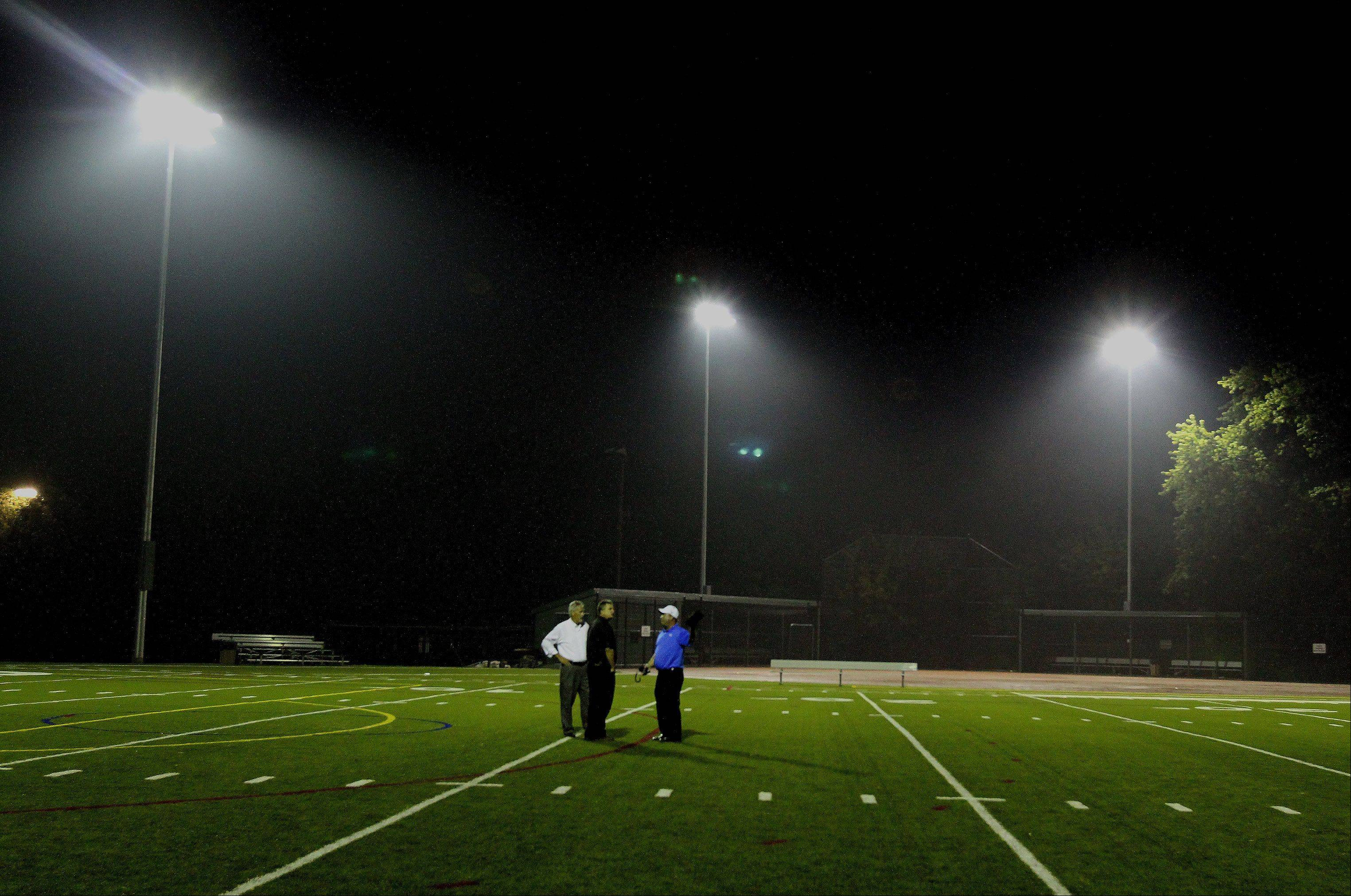 Officials test the new lights Monday at Memorial Field across the street from Glenbard West High School in Glen Ellyn.
