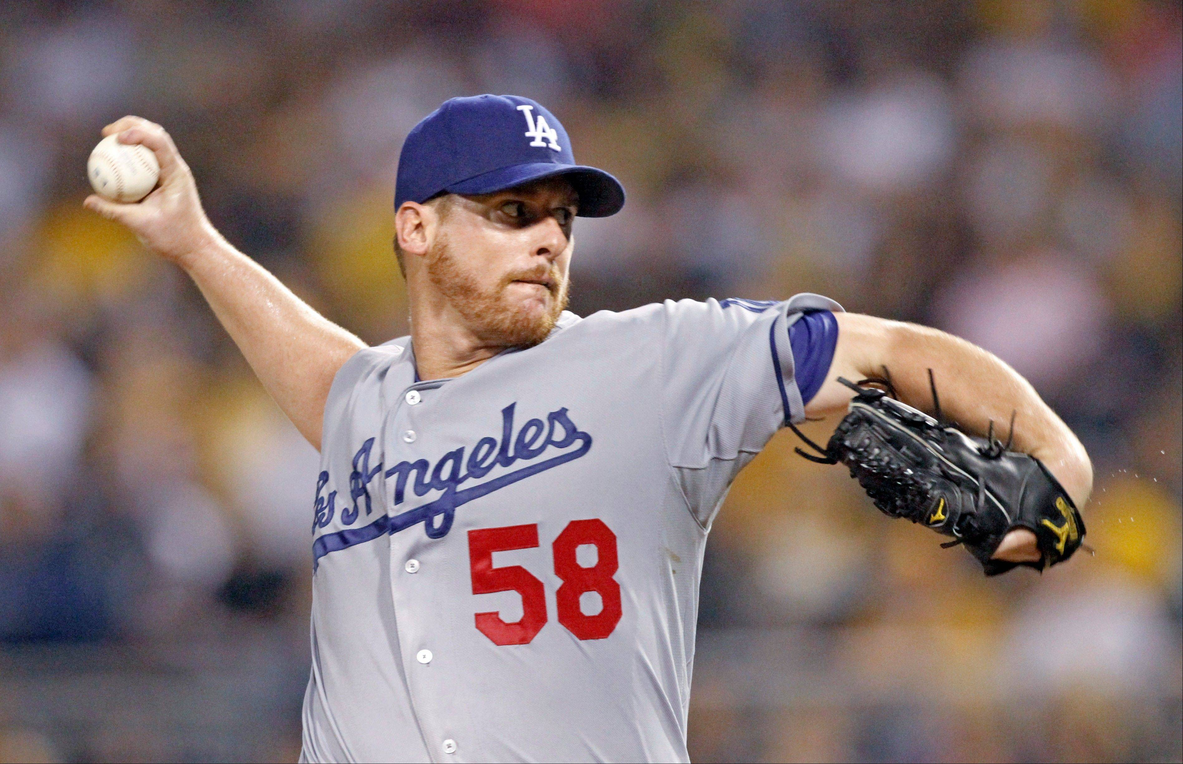 Los Angeles Dodgers starting pitcher Chad Billingsley throws to a Pittsburgh Pirates batter in the sixth inning of the baseball game Tuesday, Aug. 14, 2012, in Pittsburgh. The Dodgers won 11-0.
