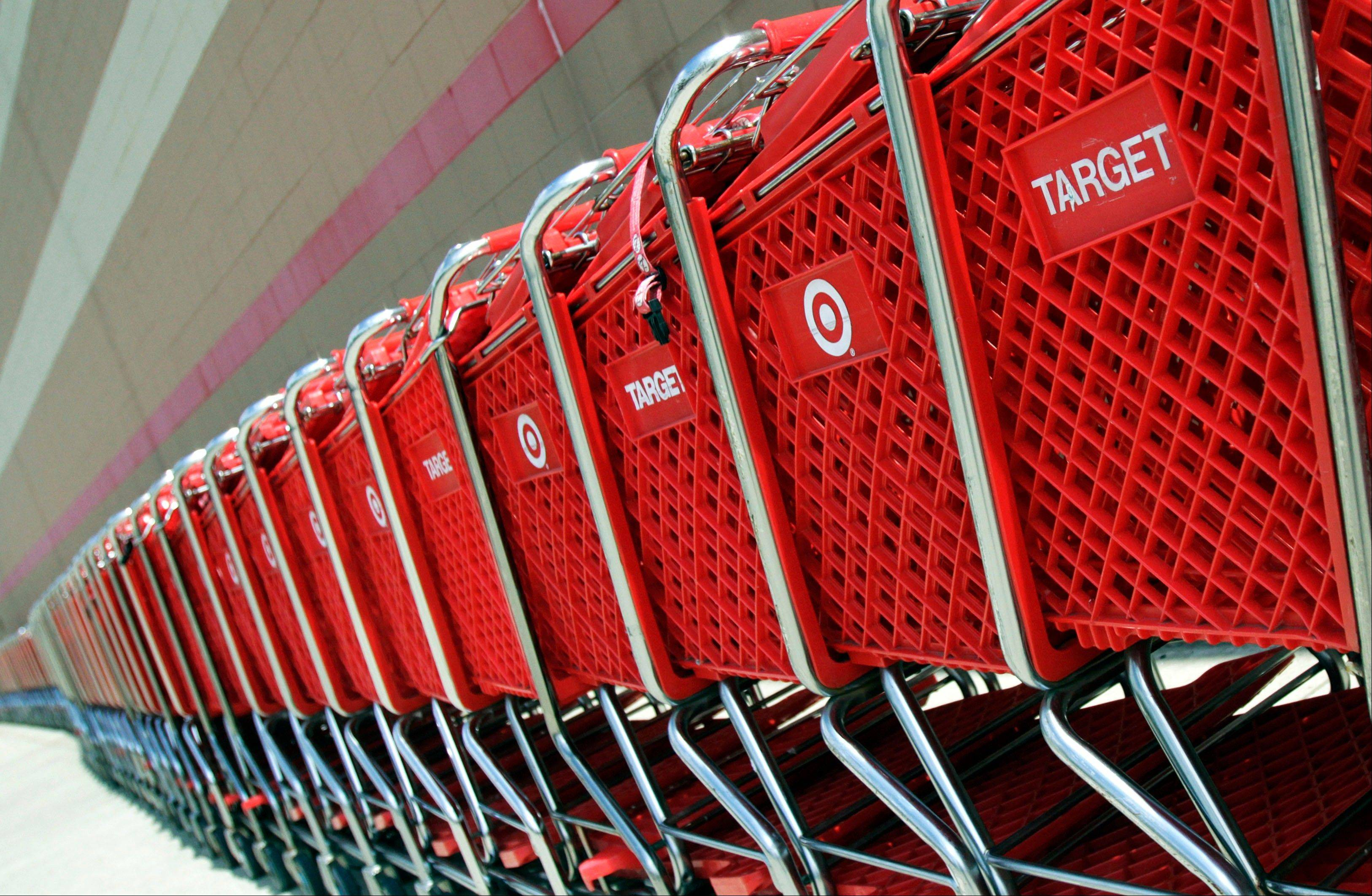 Shopping carts sit parked outside a Target store in Marlborough, Mass.