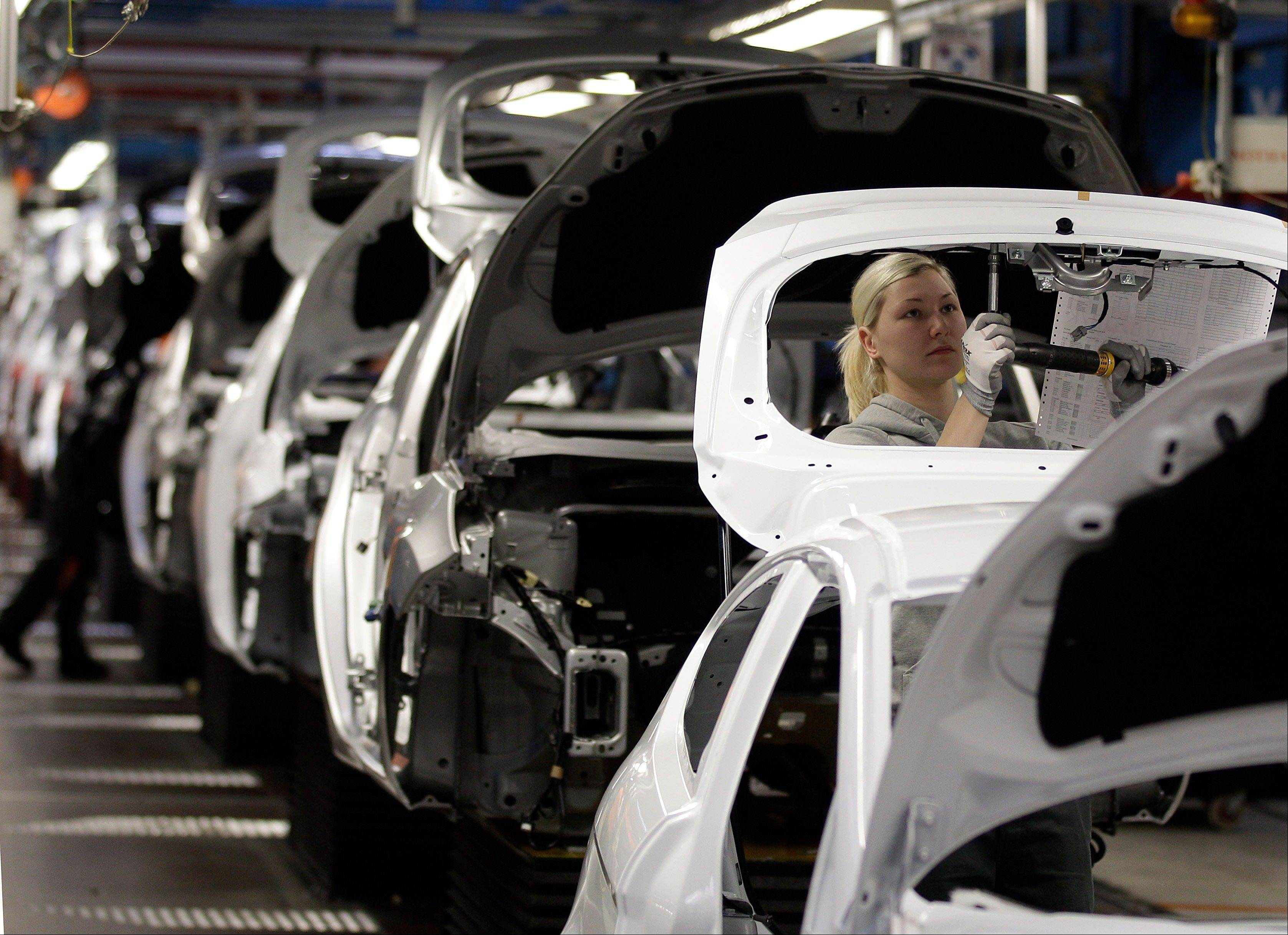 Workers build Ford Fiesta�s at a Ford factory in Cologne, Germany. Germany�s economy, Europe�s largest, grew a larger-than-expected 0.3 per cent in the second quarter as consumer spending and strong exports helped stave off effects of the eurozone debt crisis, the Federal Statistical Office said Tuesday.
