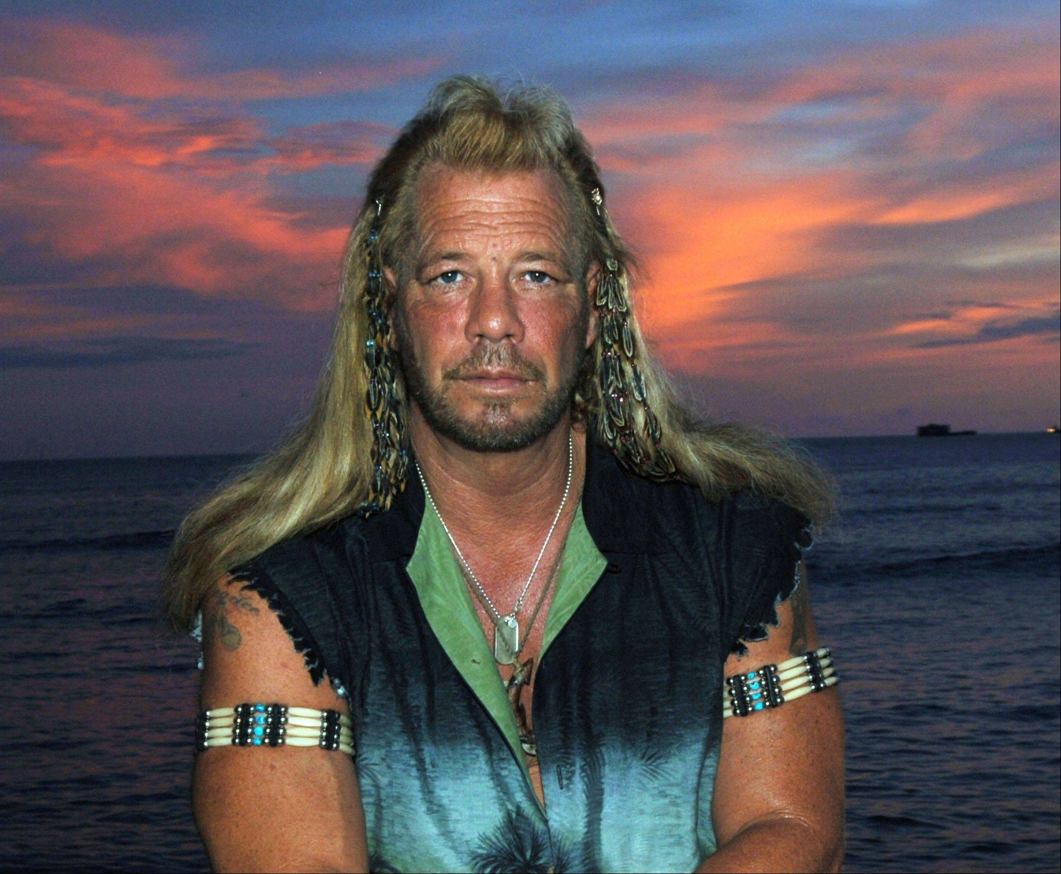 Duane �Dog� Chapman, star of �Dog the Bounty Hunter,� has his bags packed for London, but a murder conviction from the late 1970s is keeping him out of the United Kingdom. He was to appear on another reality show, �Celebrity Big Brother,� but he has been denied a visa.