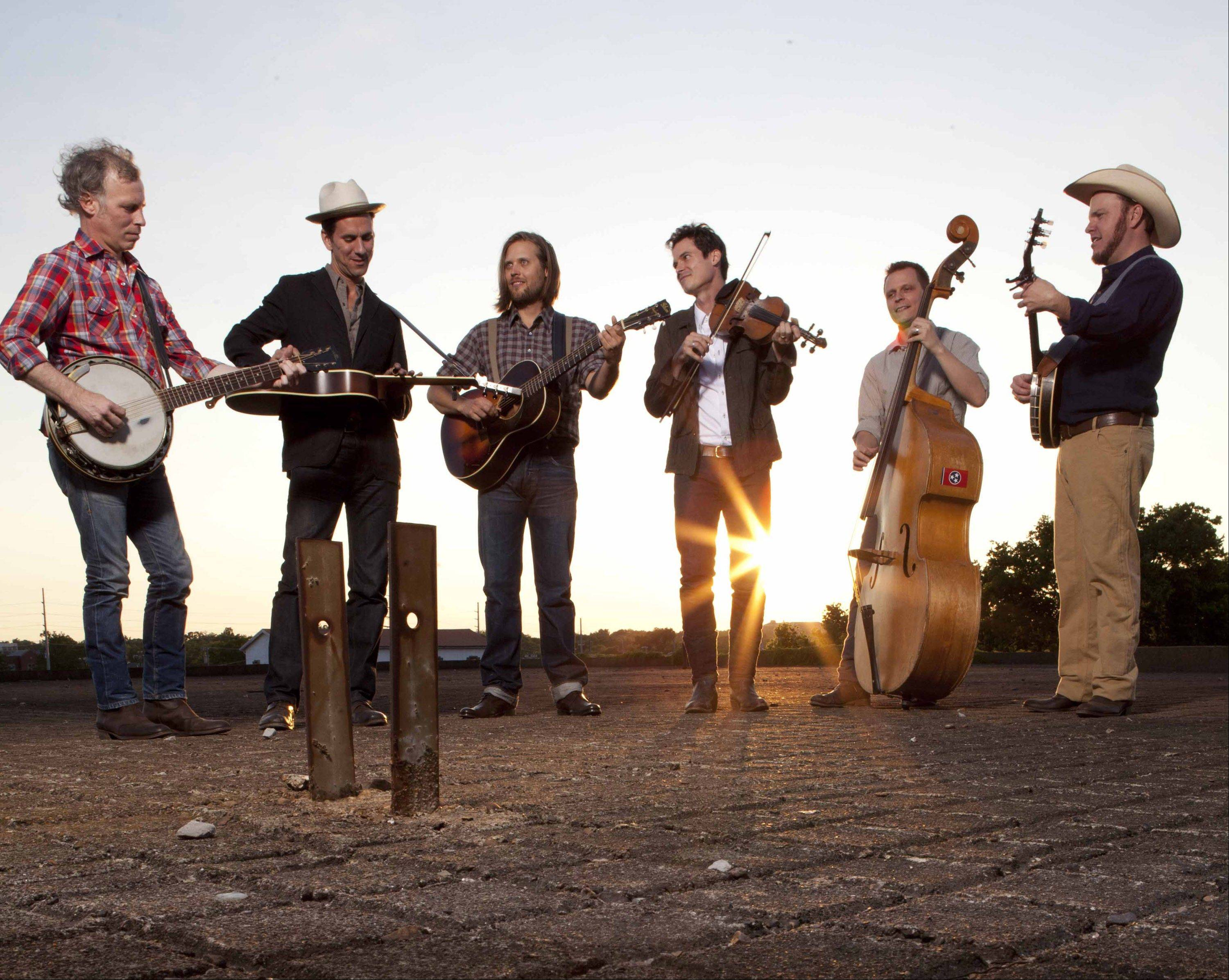 "Old Crow Medicine Show — Kevin Hayes, left, Gill Landry, Chance McCoy, Ketch Secor, Morgan Jahnig and Critter Fuqua — recently release the band's fourth album, ""Carry Me Back."""