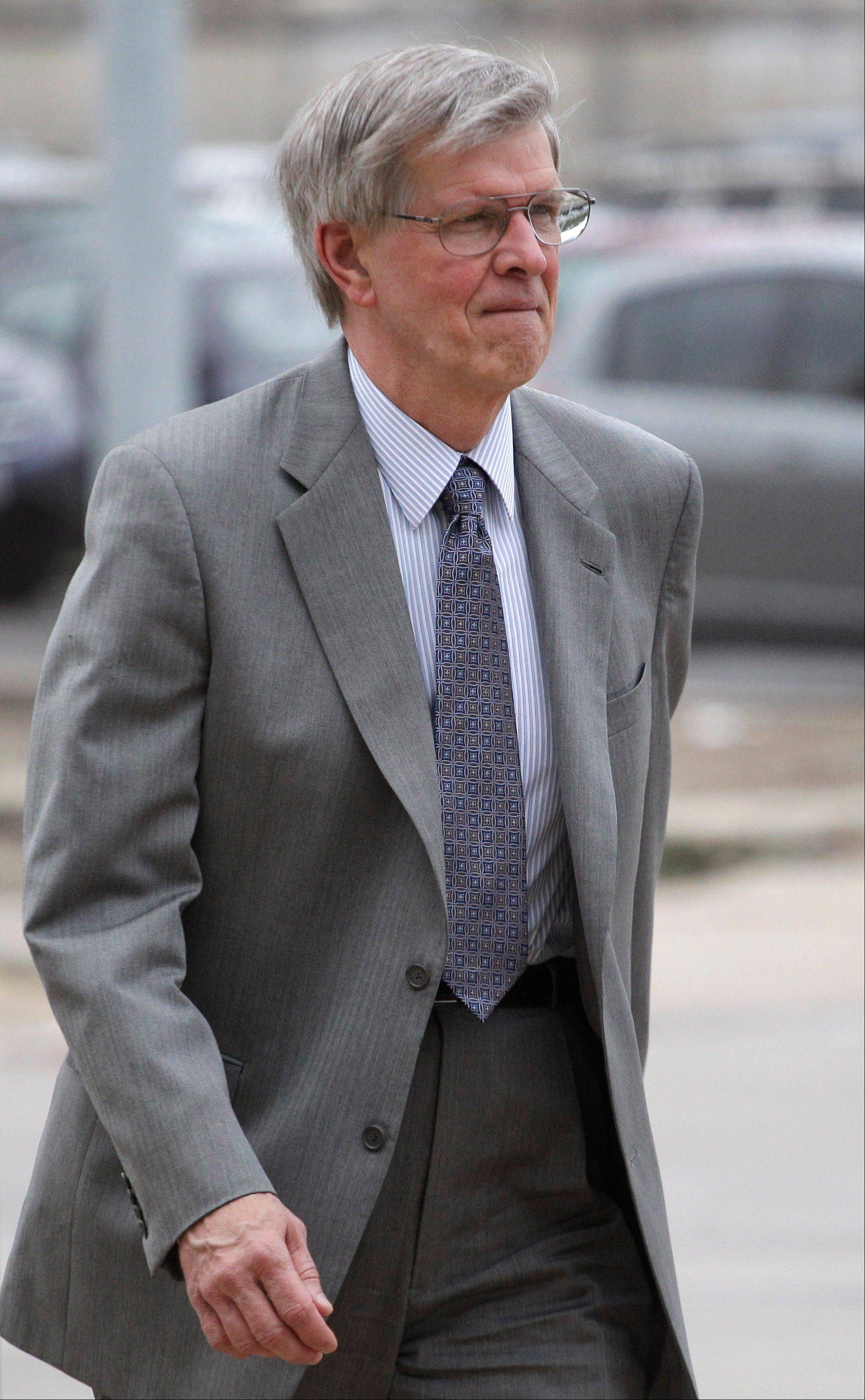 Judge Edward Burmila enters the Will County courthouse as Drew Peterson�s murder trial continues Wednesday in Joliet.