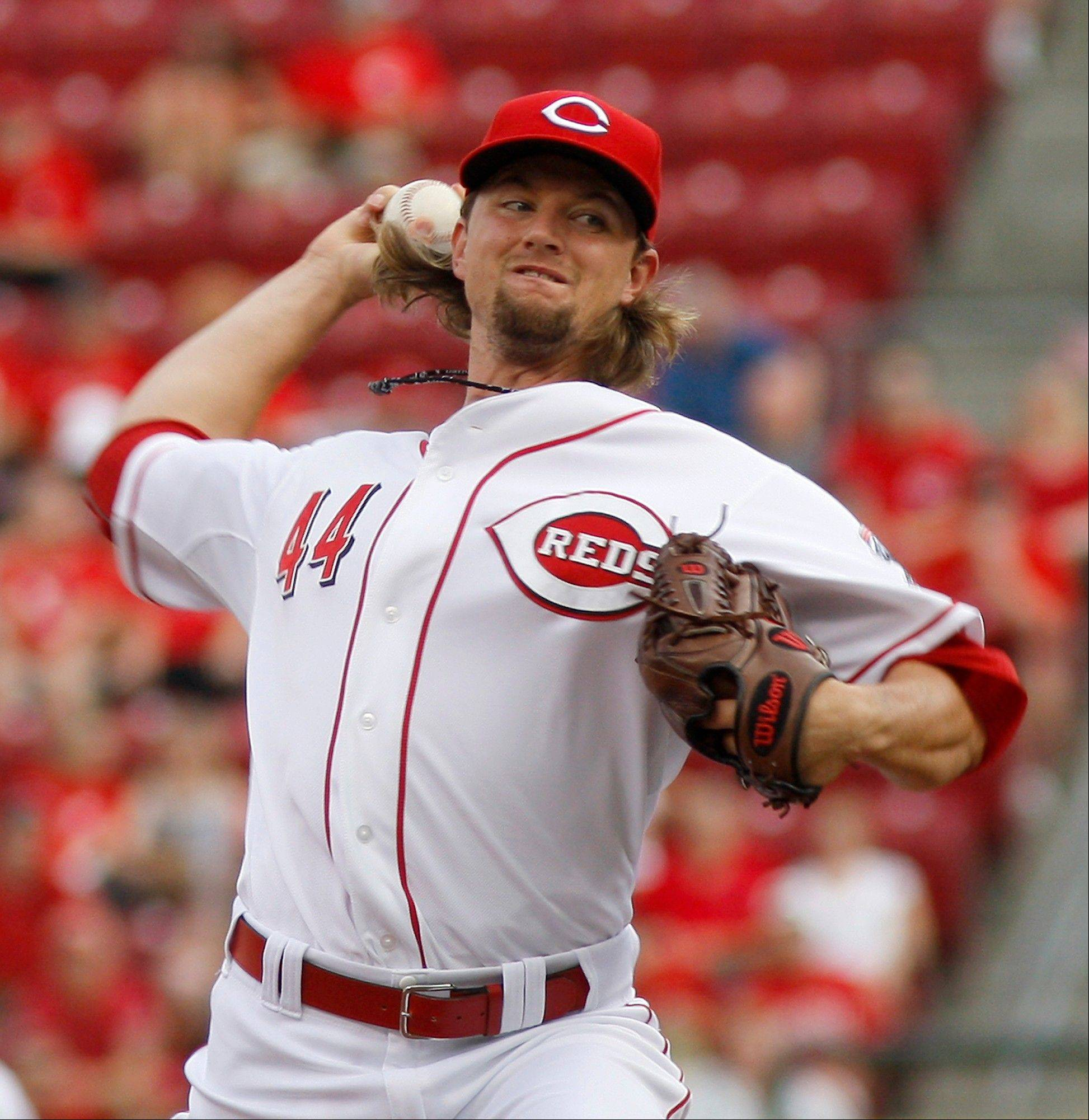 Cincinnati Reds starting pitcher Mike Leake throws against the New York Mets in the first inning during a baseball game, Wednesday, Aug. 15, 2012, in Cincinnati. (AP Photo/David Kohl)