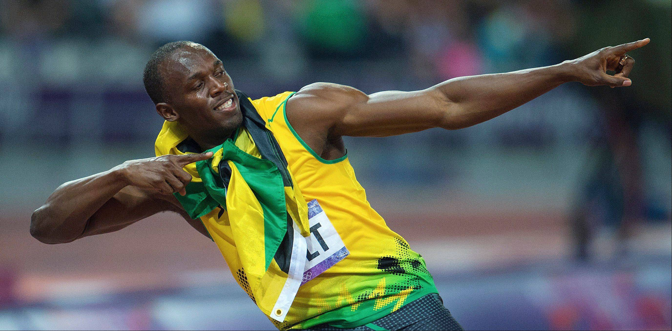 Jamaica�s Usain Bolt poses after his win in the men�s 200 meters at the Summer Olympics in London. Several Olympic sprinters have played in the NFL after successful careers on the track.
