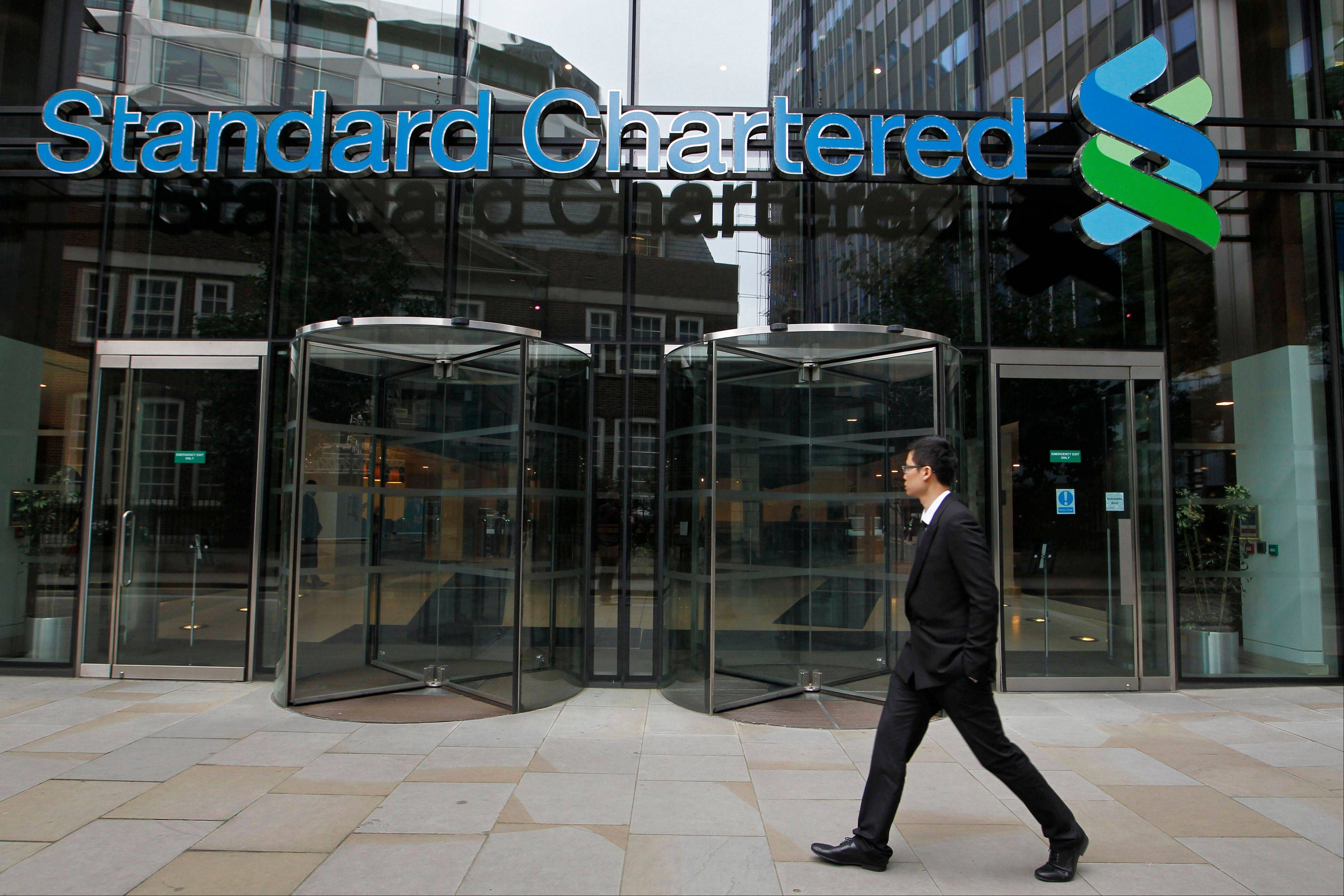 Britain's Standard Chartered bank, accused of scheming with the Iranian government to launder billions of dollars, will be subject to two years of monitoring at its New York branch and will permanently install personnel to oversee and audit offshore monitoring as part of a $340 million settlement with financial regulators.