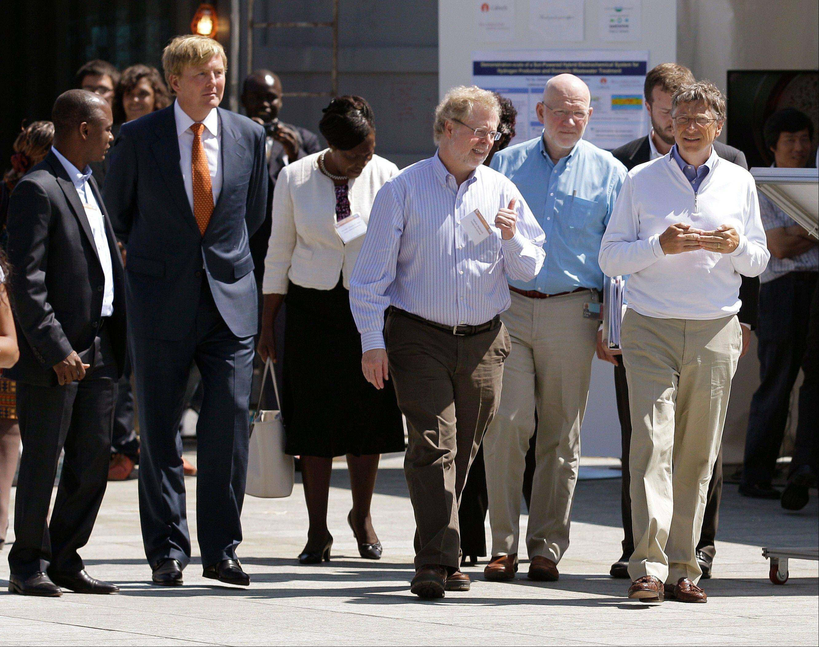 "Bill Gates, right, walks with guests at the ""Reinventing the Toilet"" Fair, Tuesday in Seattle."