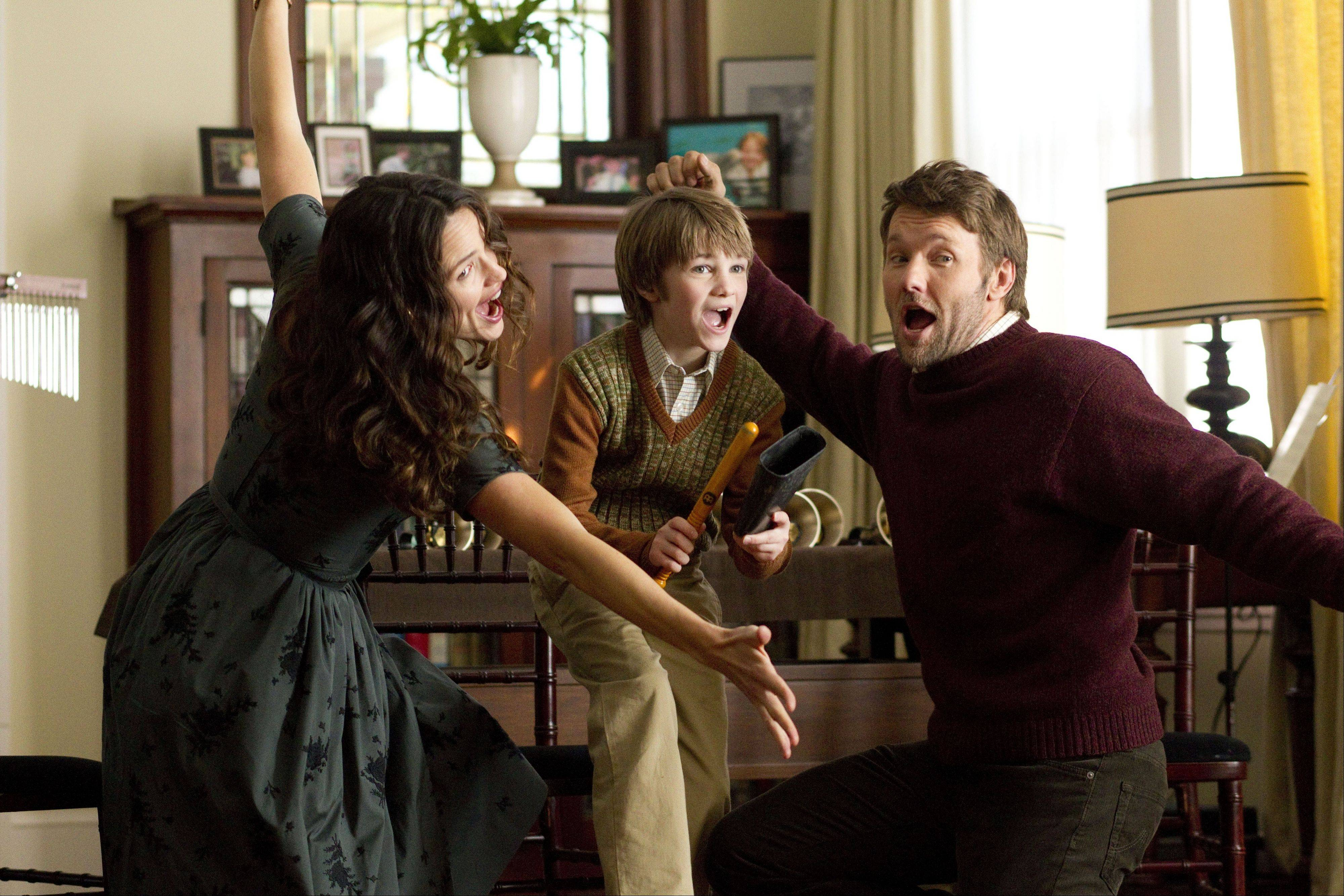 "Cindy (Jennifer Garner), Timothy (C.J. Adams) and Jim (Joel Edgerton) wow friends and family with an impromptu performance in the botanical fantasy ""The Odd Life of Timothy Green."""