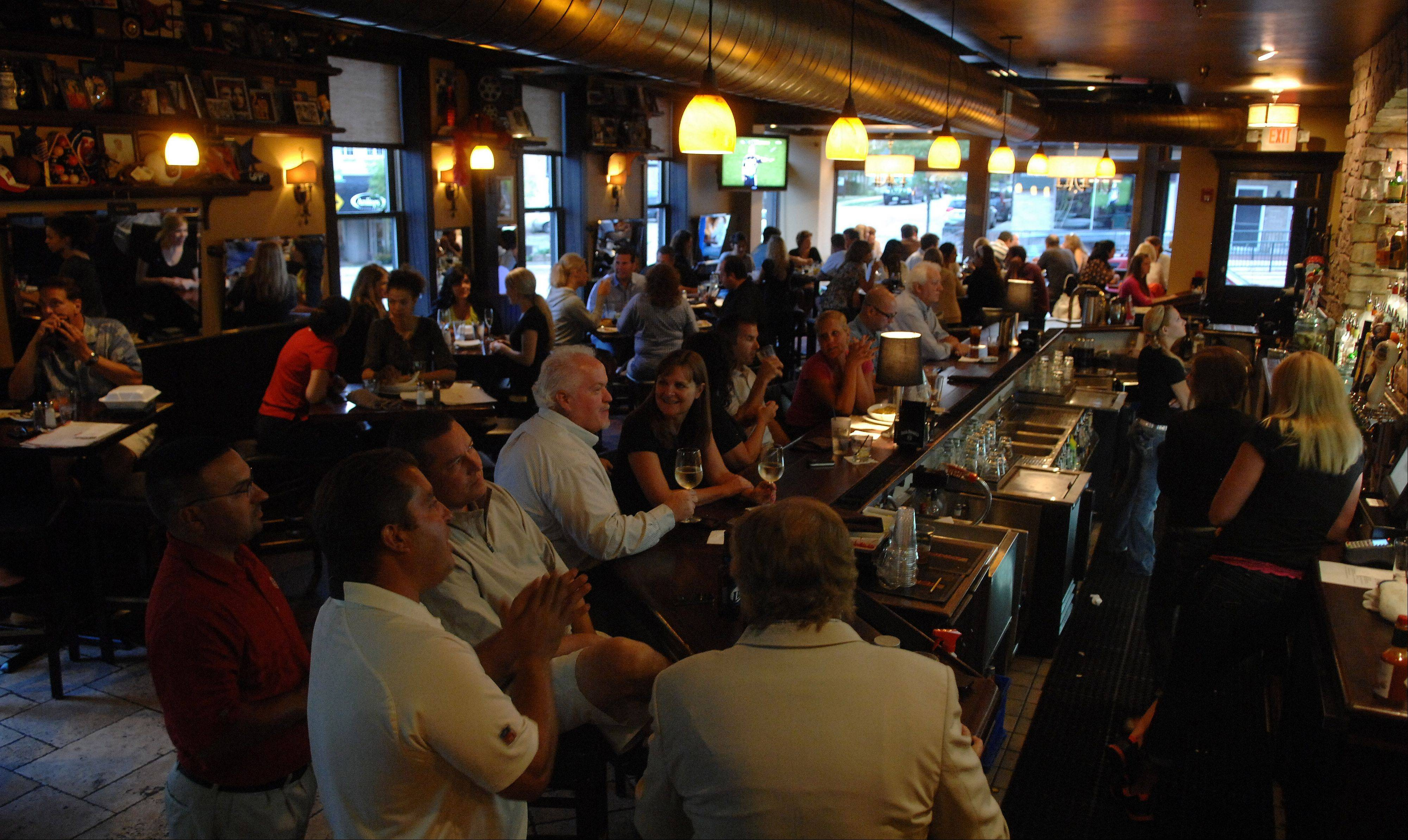The bar and dining room are full at The Office in St. Charles on a recent Thursday.
