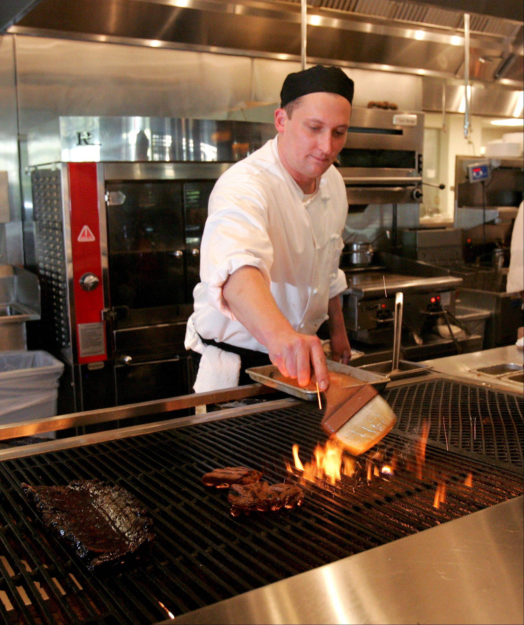 Chef Jeff Aire mans the wood-fired grill at Bakersfield Restaurant in Westmont.