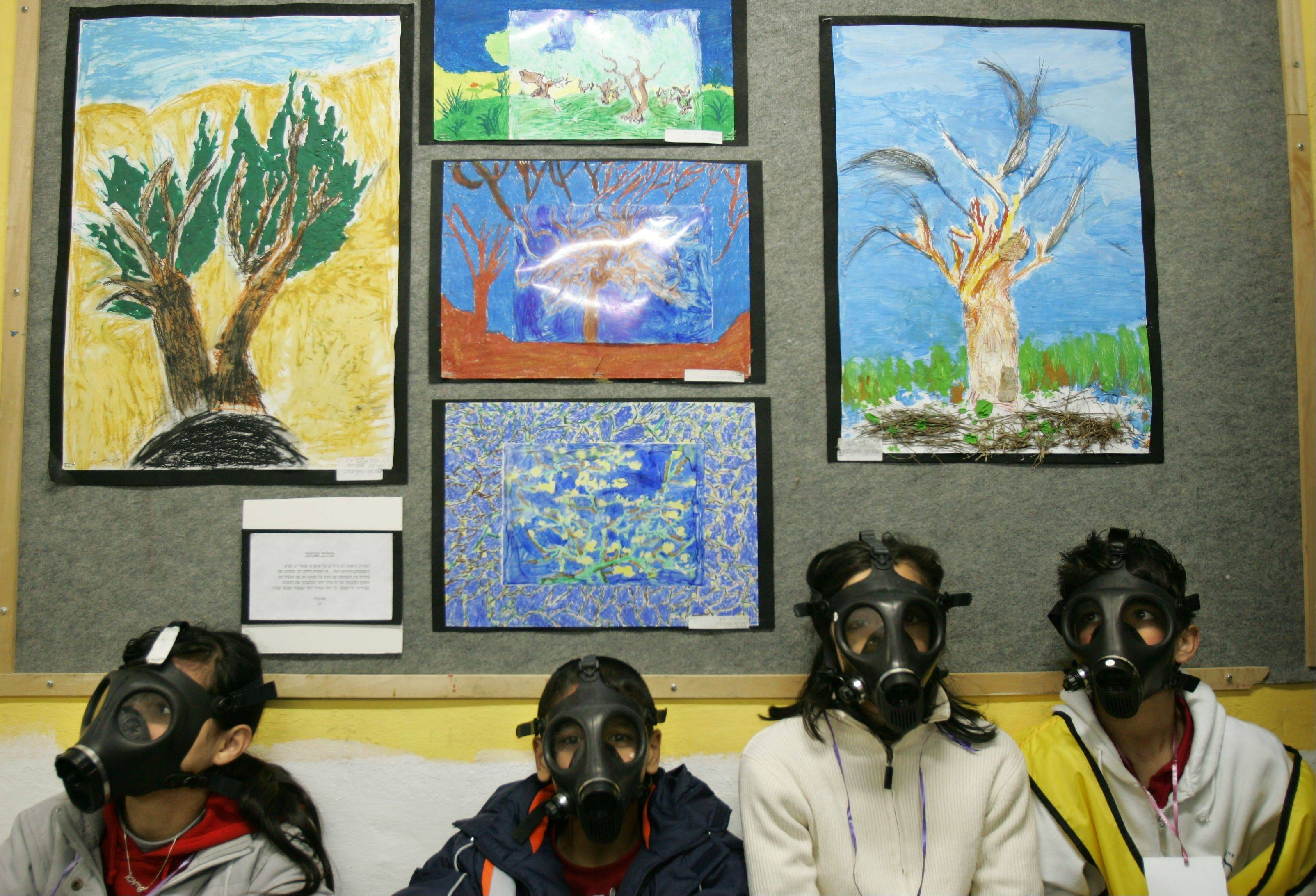 Associated Press/March 15, 2007Israeli school children wear gas masks during a drill organized by the Israeli Home Front Command, simulating a chemical missile attack in a shelter at a school in the central Israeli city of Lod. Israel's ou