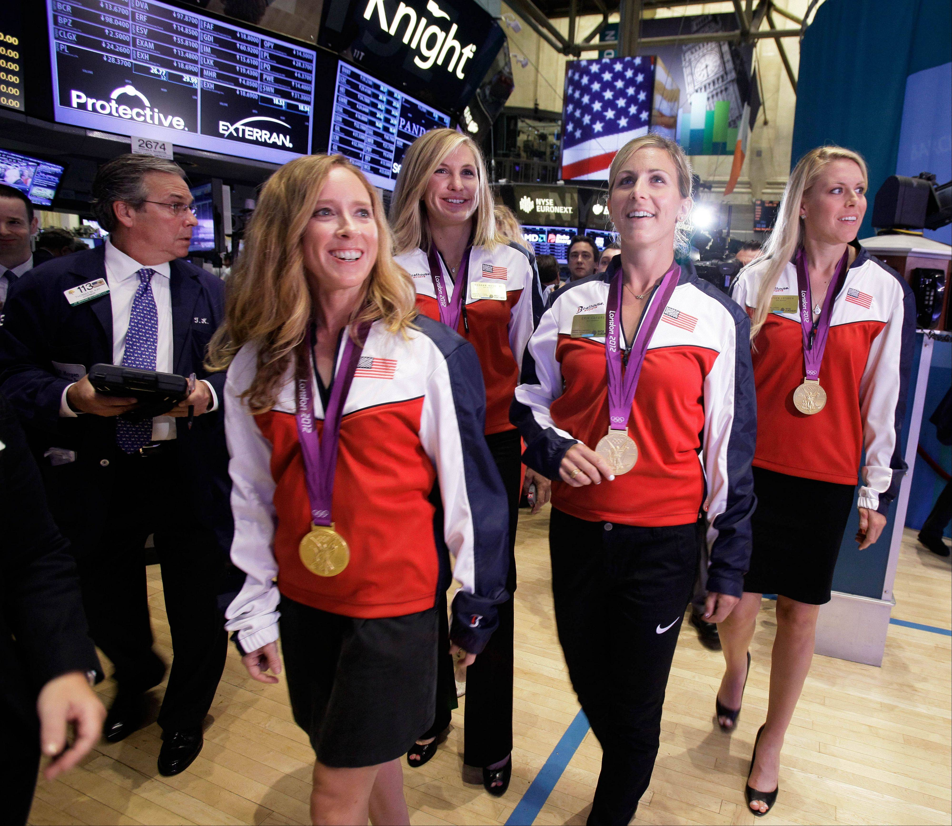 U.S. women's rowing Olympic gold medalists, from left: Mary Whipple, Meghan Mushnicki, Erin Cafaro, and Esther Lofgren, visit the trading floor of the New York Stock Exchange Wednesday before ringing the opening bell.