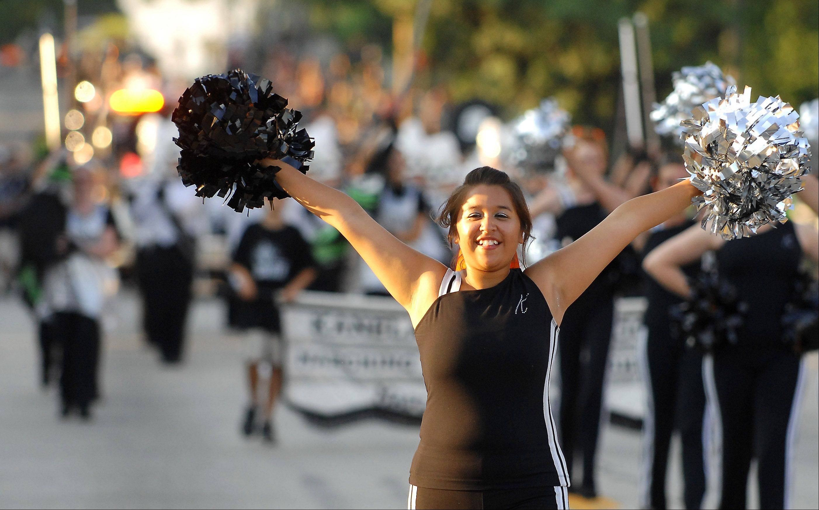 Senior Eva Aguilar and the Kaneland High School poms lead the band during last year's Elburn Days parade.