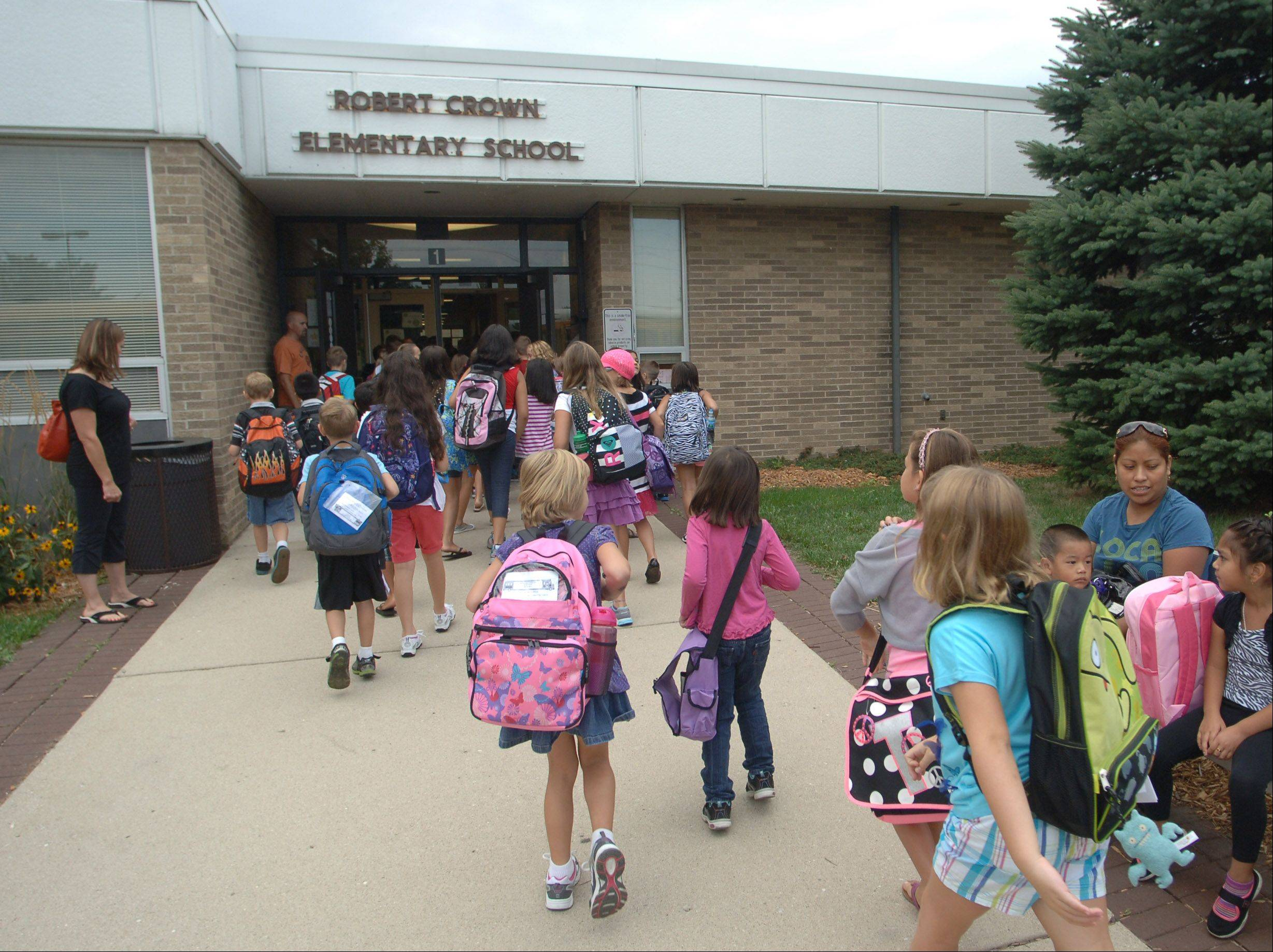 Students head into Robert Crown School for first day of classes Wednesday in Wauconda.