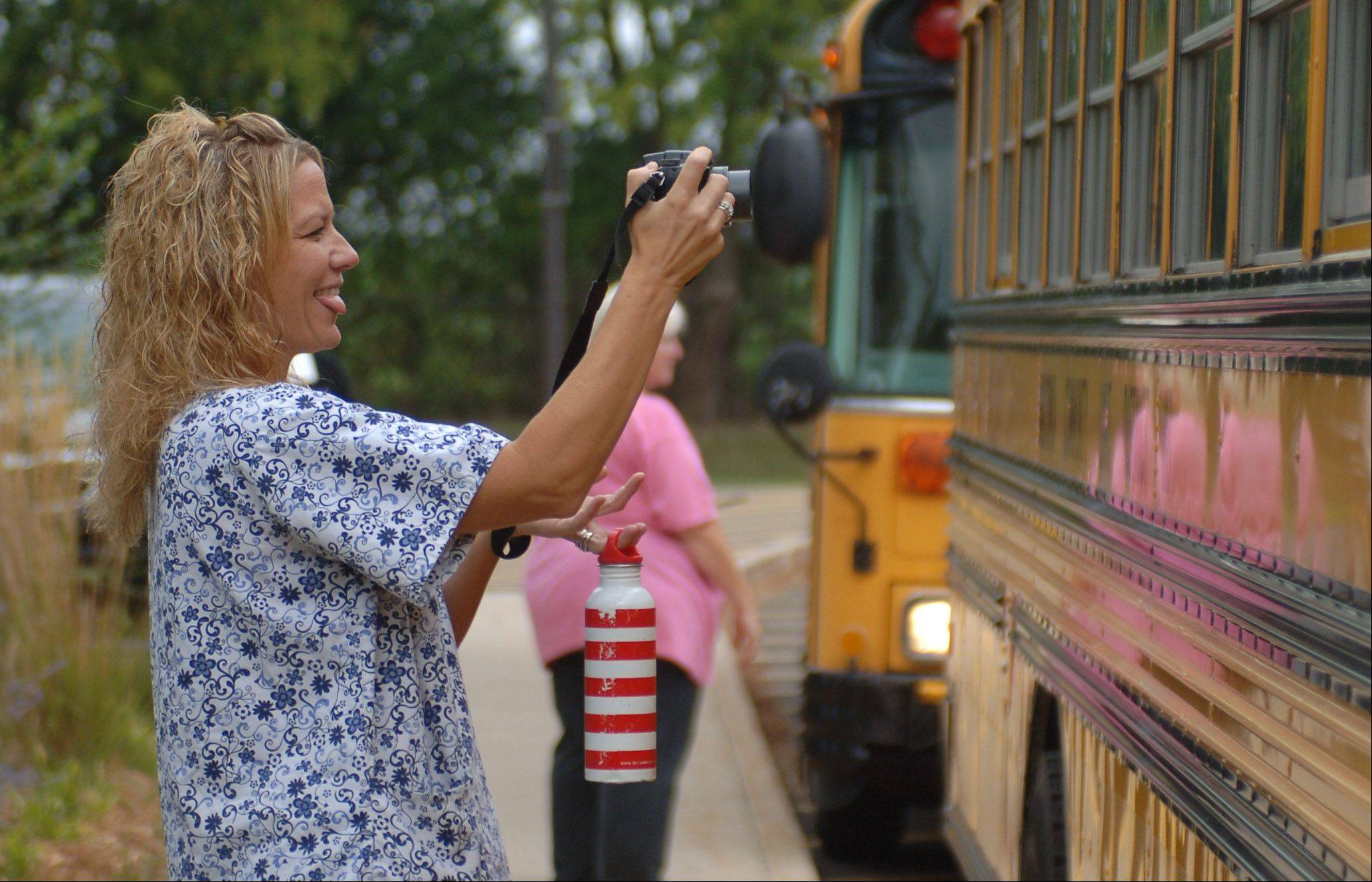 Jennifer Johnson of Lakemoor takes photos of her children as they arrive for first day of school at Robert Crown School in Wauconda Wednesday morning.