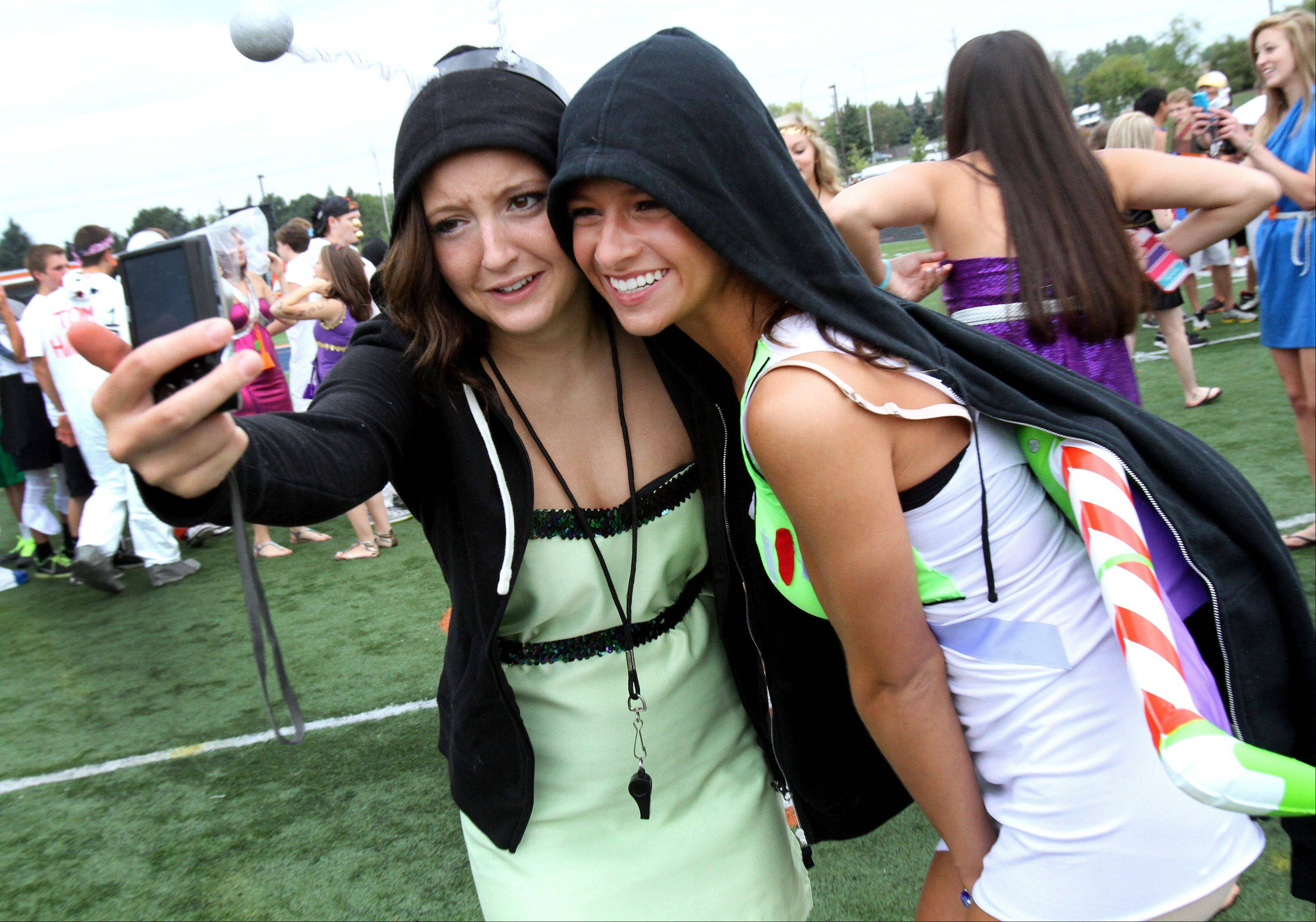 Naperville North seniors Courtney Cox, left, and Kelly Presperin dress up for first day of school Wednesday.