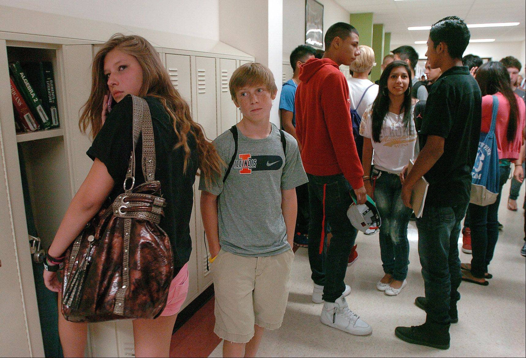 Freshman Christian Kanzler waits outside his classroom on the first day of school at Grant High School in Fox Lake Wednesday.
